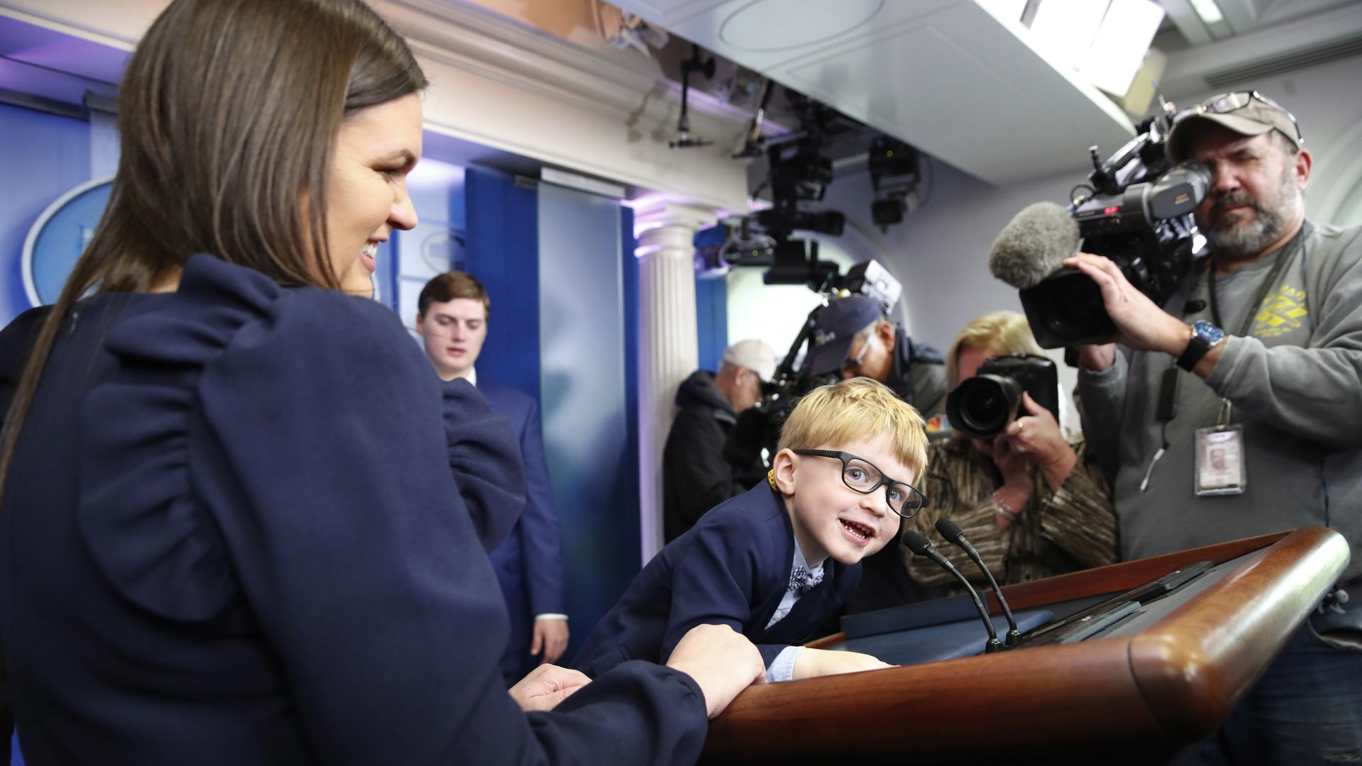 Sanders' son Huck, 4, climbed the podium during a press preview of the Thanksgiving turkey pardoning.