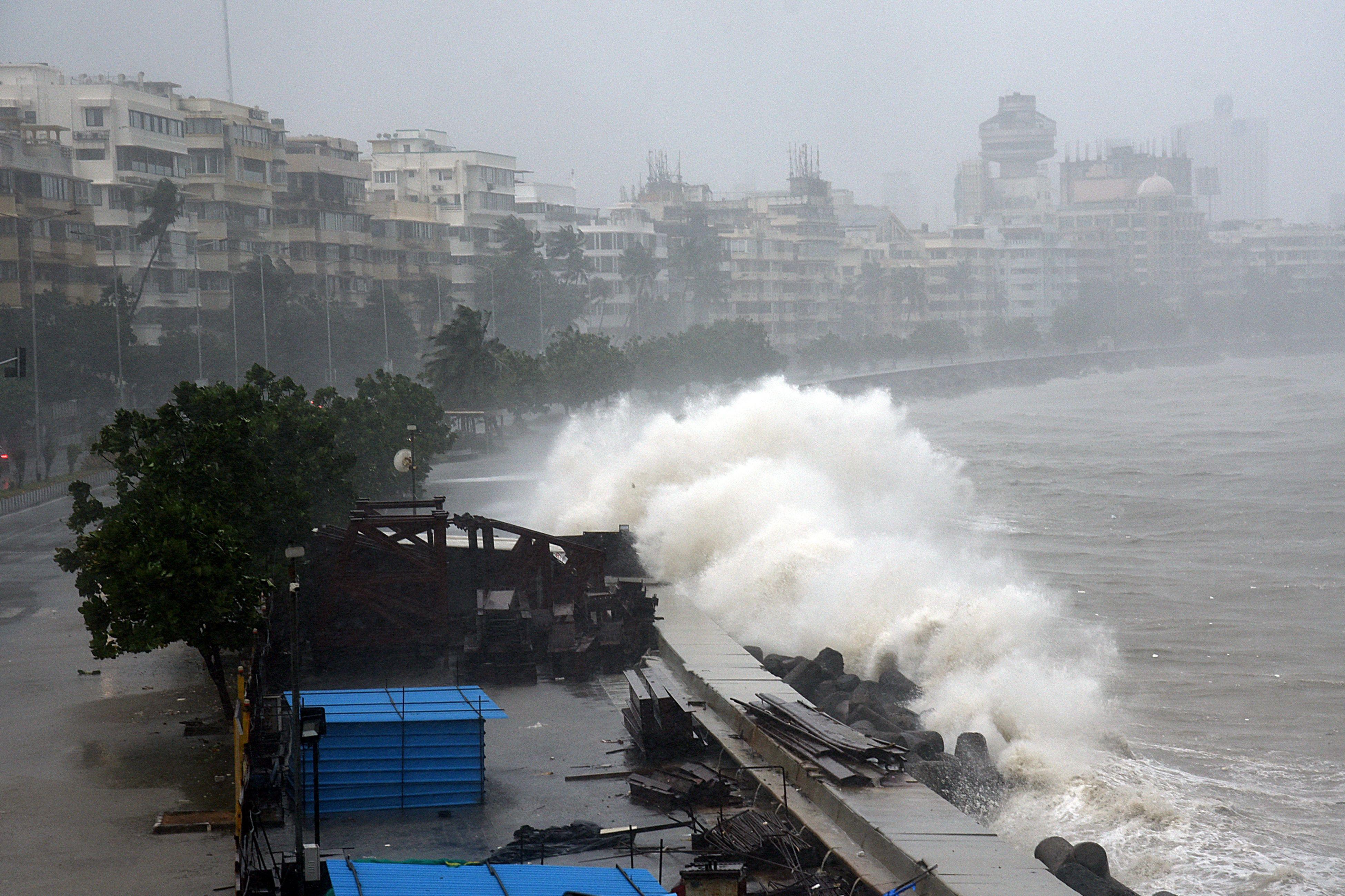 Waves lash over onto a shoreline in Mumbai on May 17, as  Cyclone Tauktae, packing ferocious winds bears down on India.