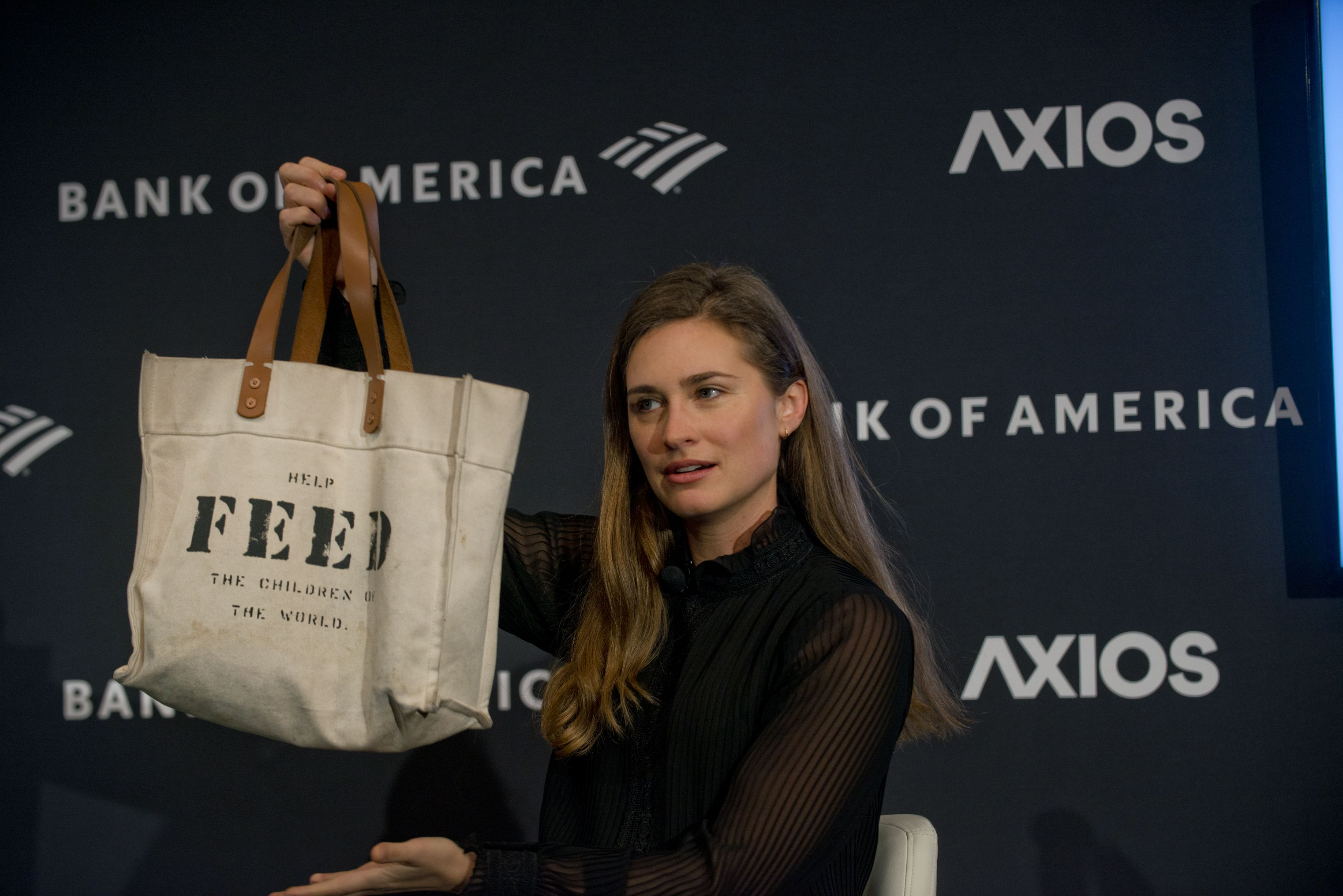 Lauren Bush Lauren holds up one of her FEED bags, demonstrating what they look like for the Axios audience