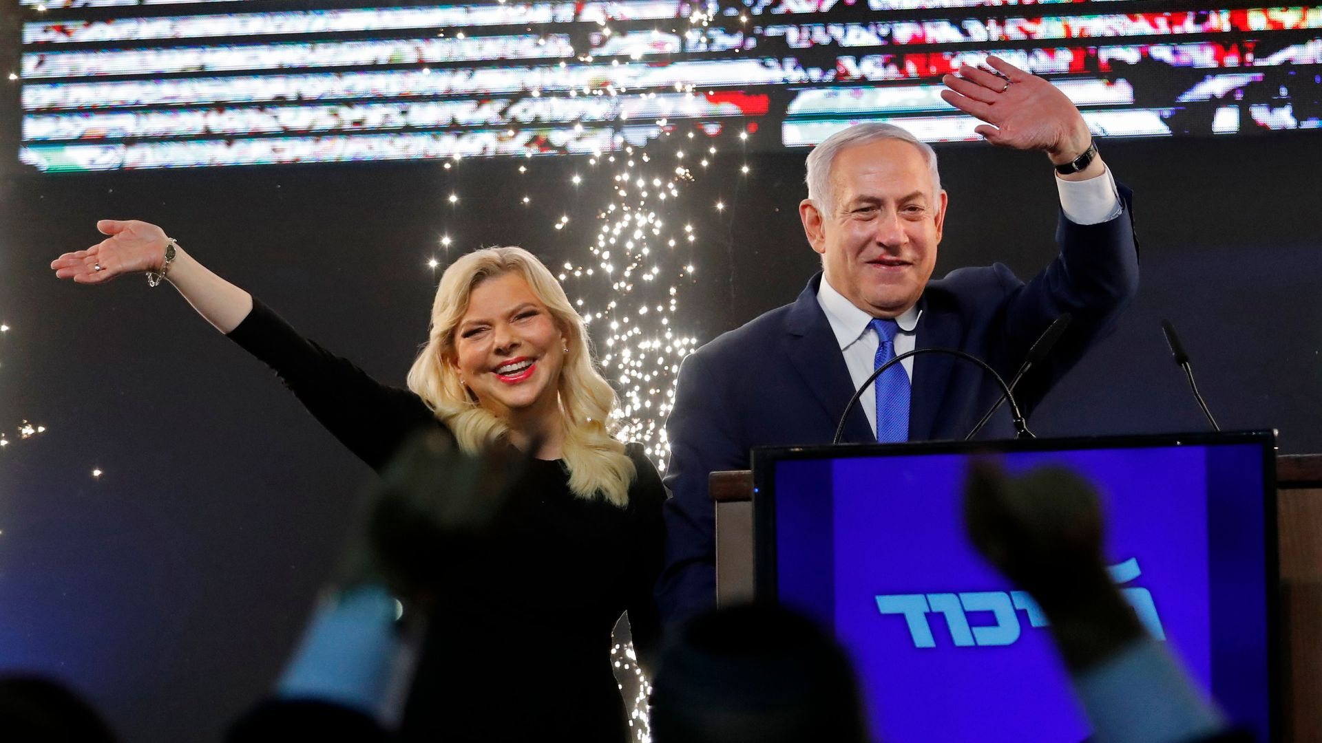 Benjamin Netanyahu and his wife, Sara, on stage before supporters
