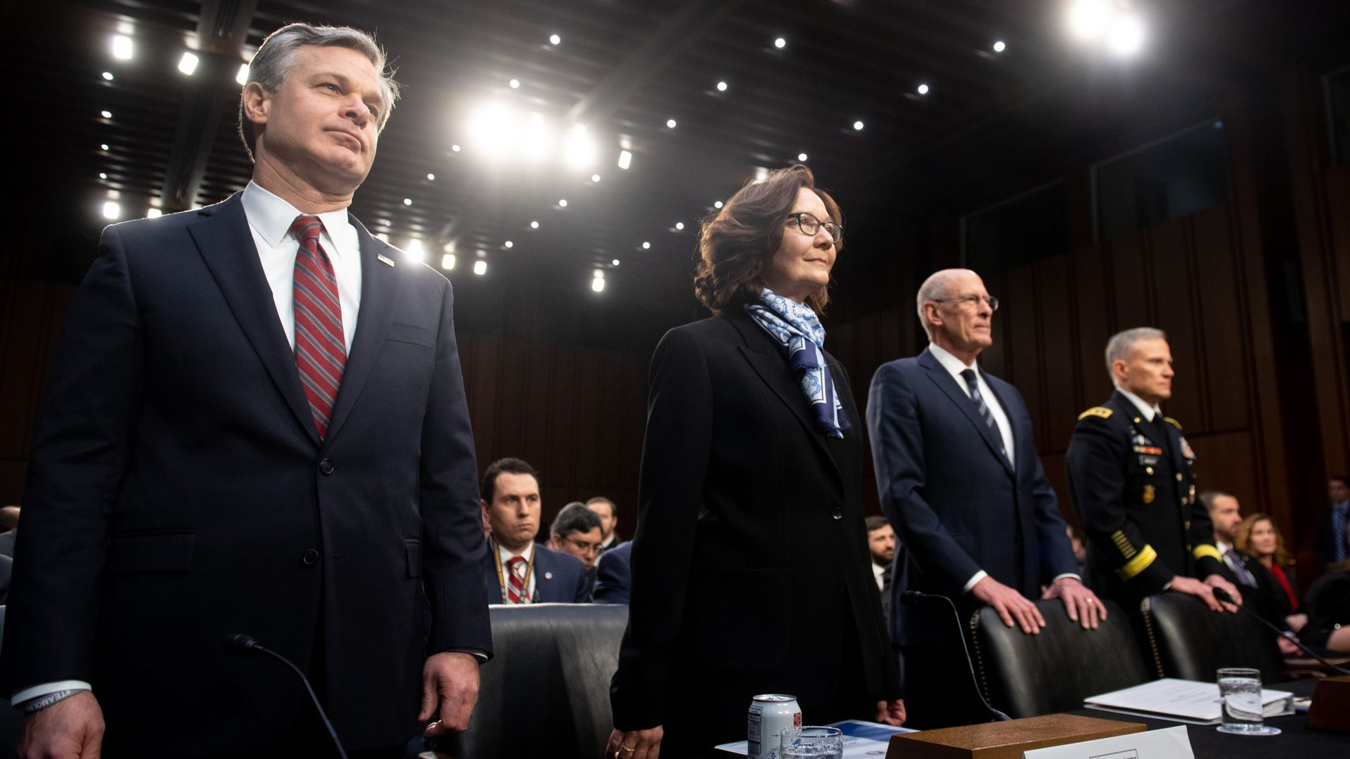 Intelligence chiefs stand at hearing.