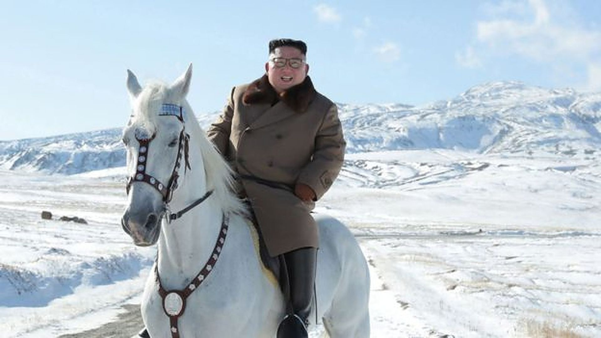 A North Korean state media photo of leader Kim Jong-un atop a white horse in the snow in North Korea.