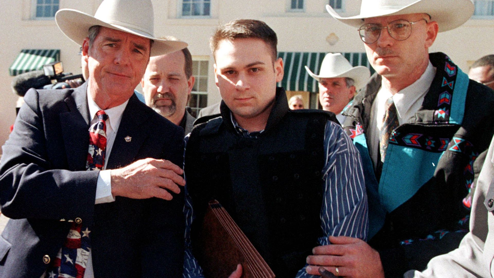 "John William ""Bill"" King (C) is led from the Jasper County Courthouse by unidentified deputies following the first day of jury selection in his murder trial 25 January in Jasper, Texas"