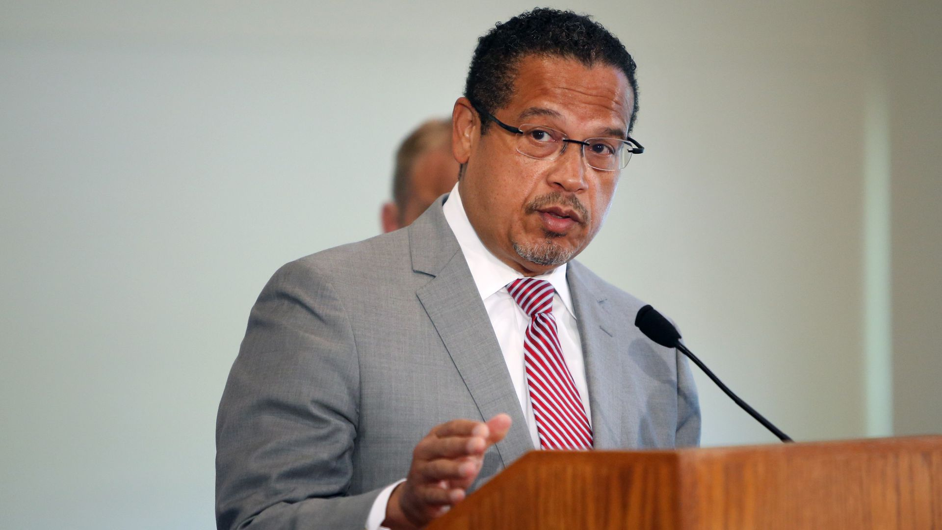 A photo of Minnesota Attorney General Keith Ellison speaking at a podium.