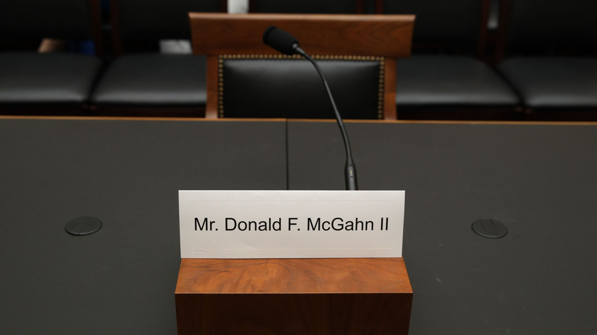 This image shows a placard for McGahn in front of an empty seat.