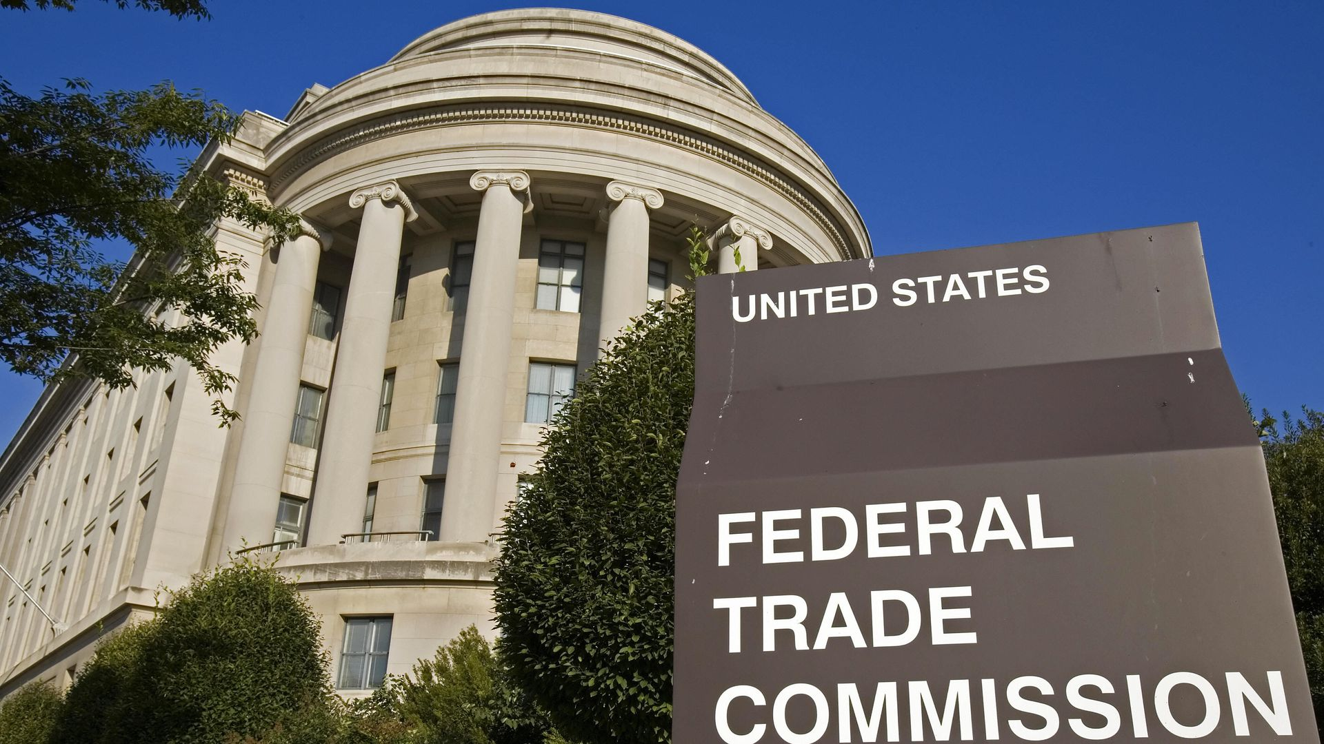The Federal Trade Commission's building in Washington, DC, stands behind a sign for the agency