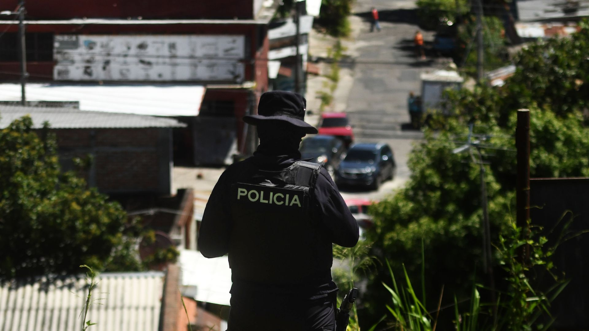 A police officer patrols an area beset by gang members in San Salvador.