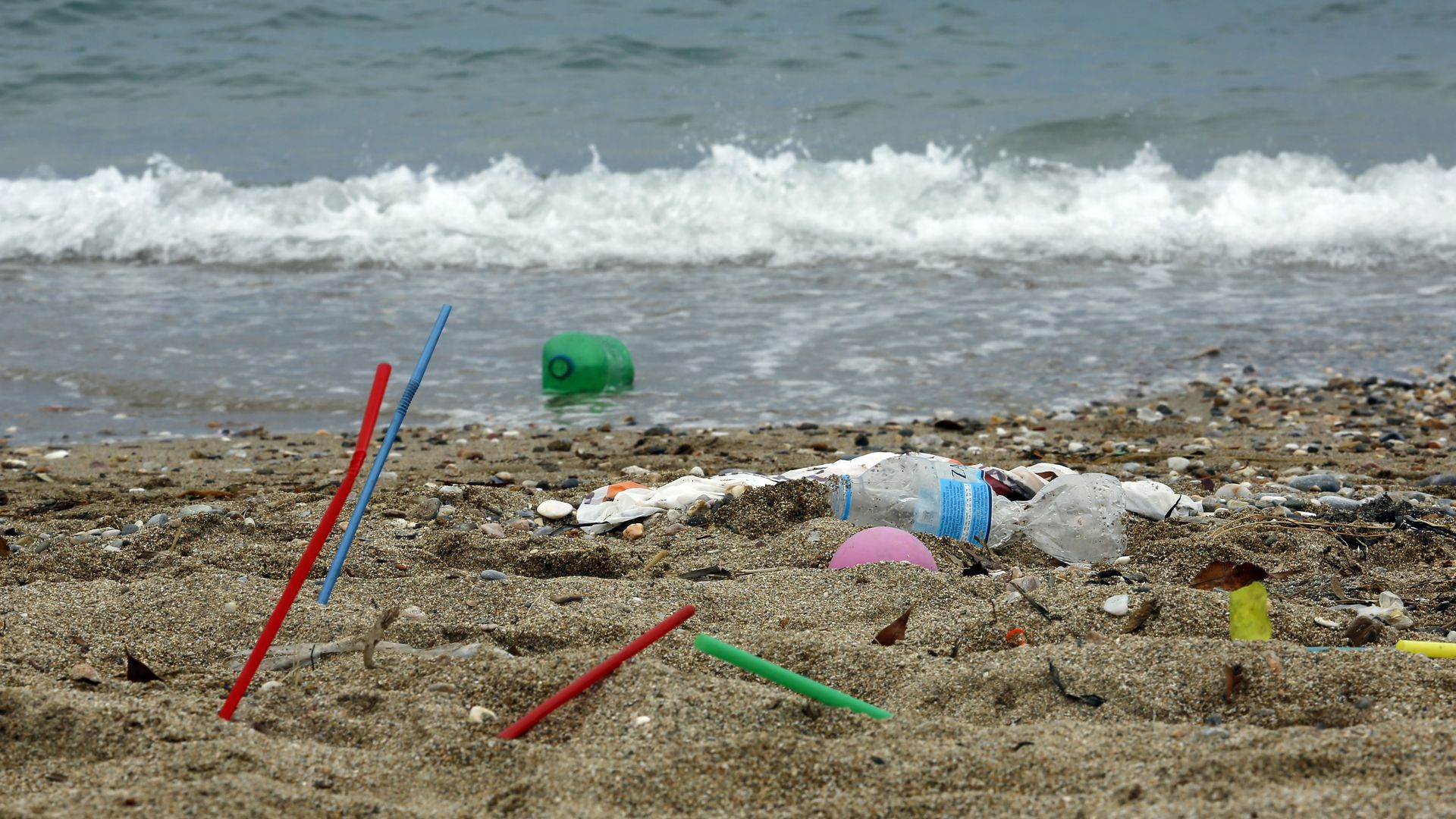 Plastic garbage lying on the Aegean sea beach near Athens on June 26, 2018 , Greece