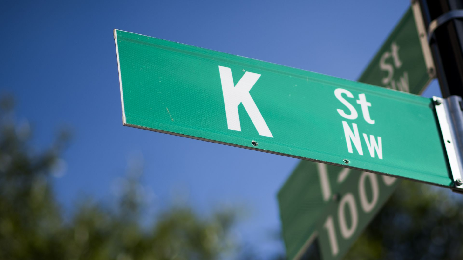 K street sign, in a reference to the lobbying hub in D.C.