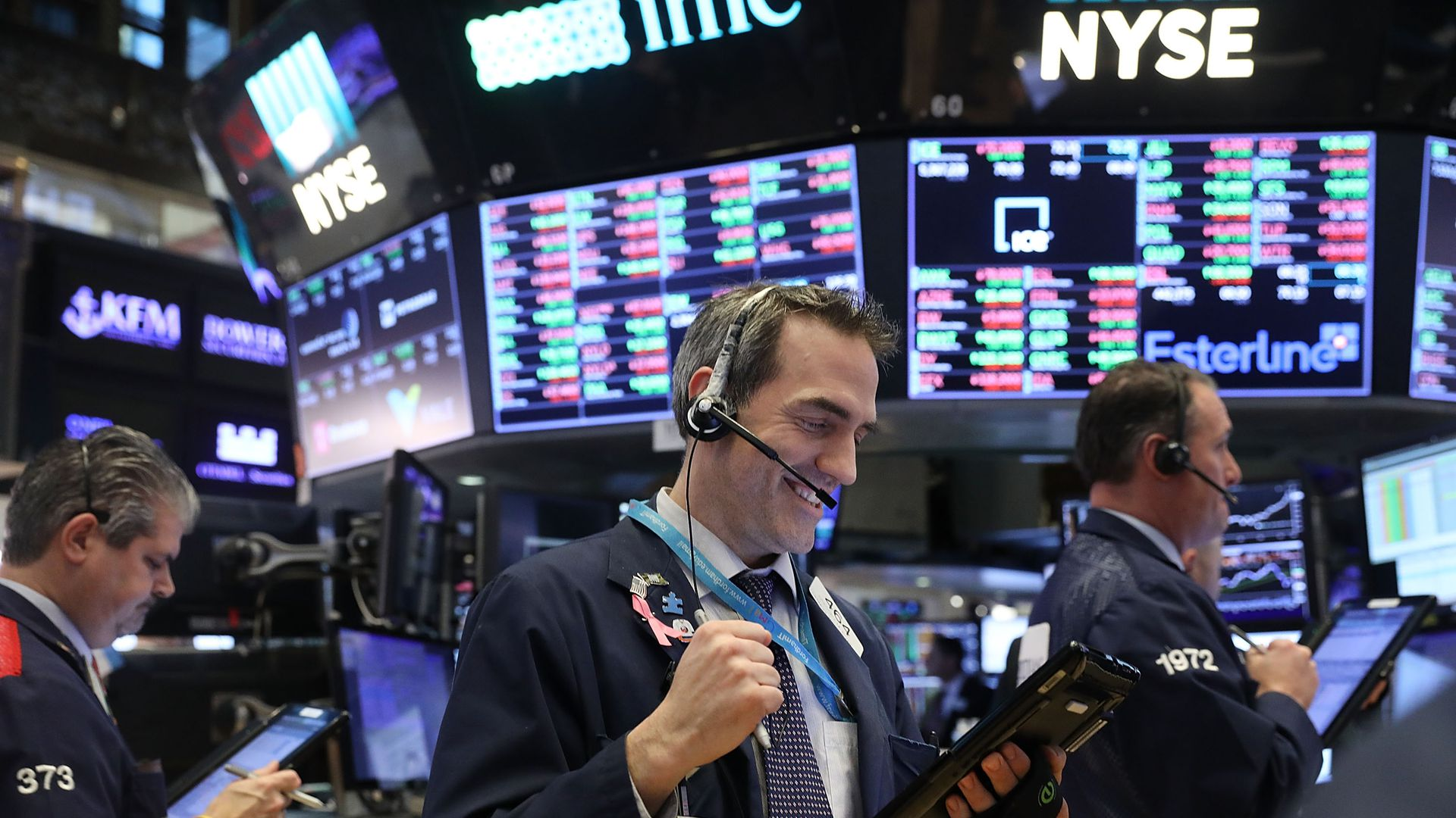 An excited trader on the floor of the stock exchange.