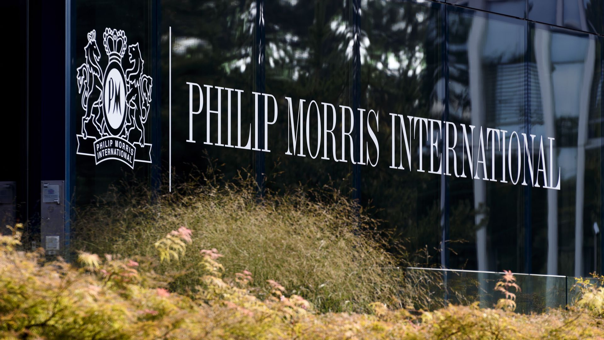 "The words ""Phillip Morris International"" written on the side of its headquarters"
