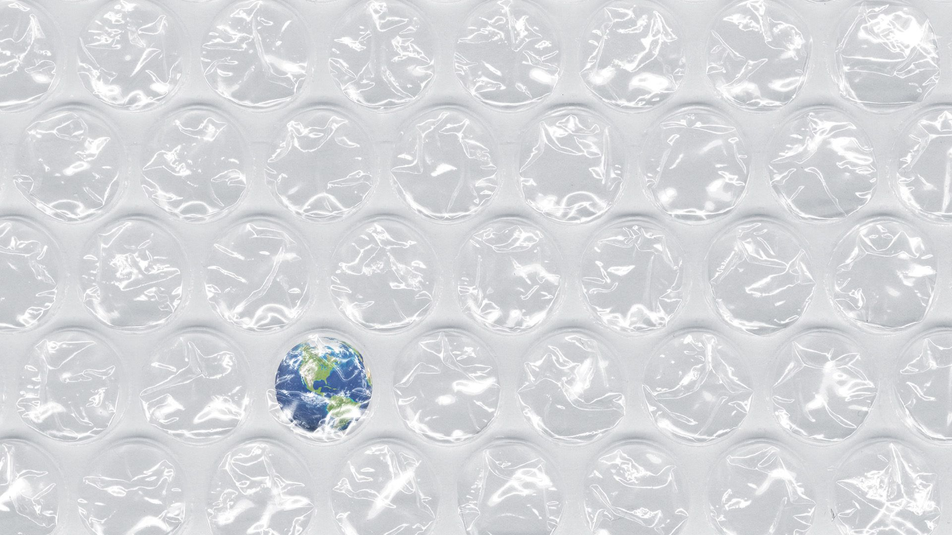 Illustration of plastic bubble wrap with one bubble including the Earth.