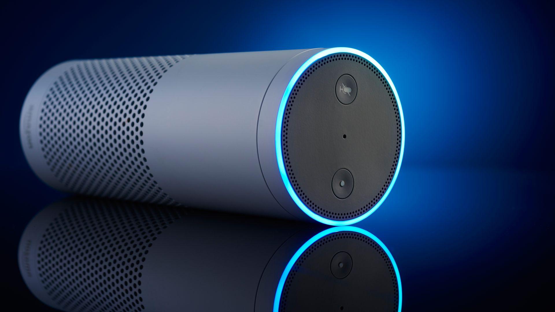 An Echo speaker against a blue backdrop