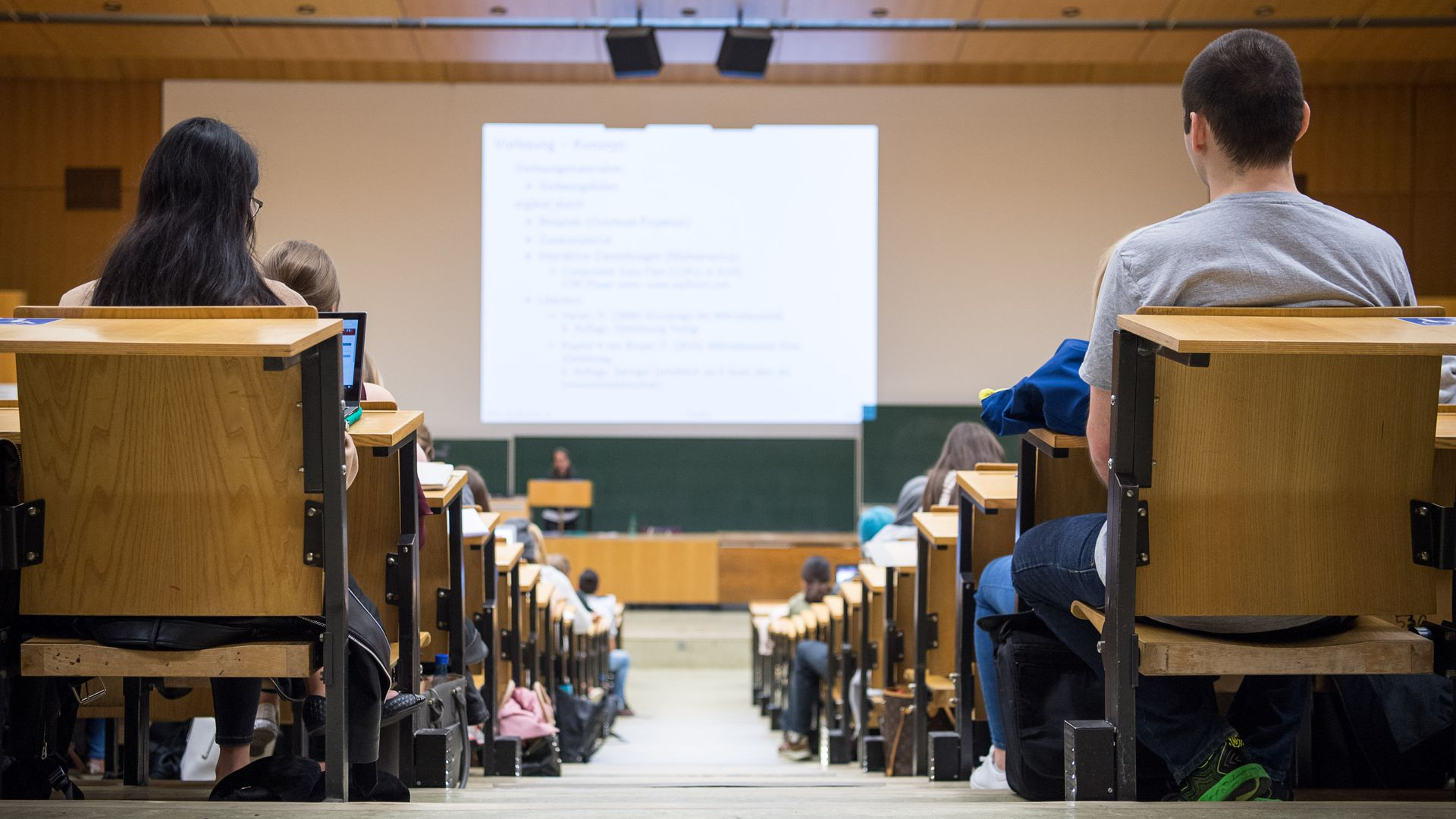 A photo of a full lecture hall from the back