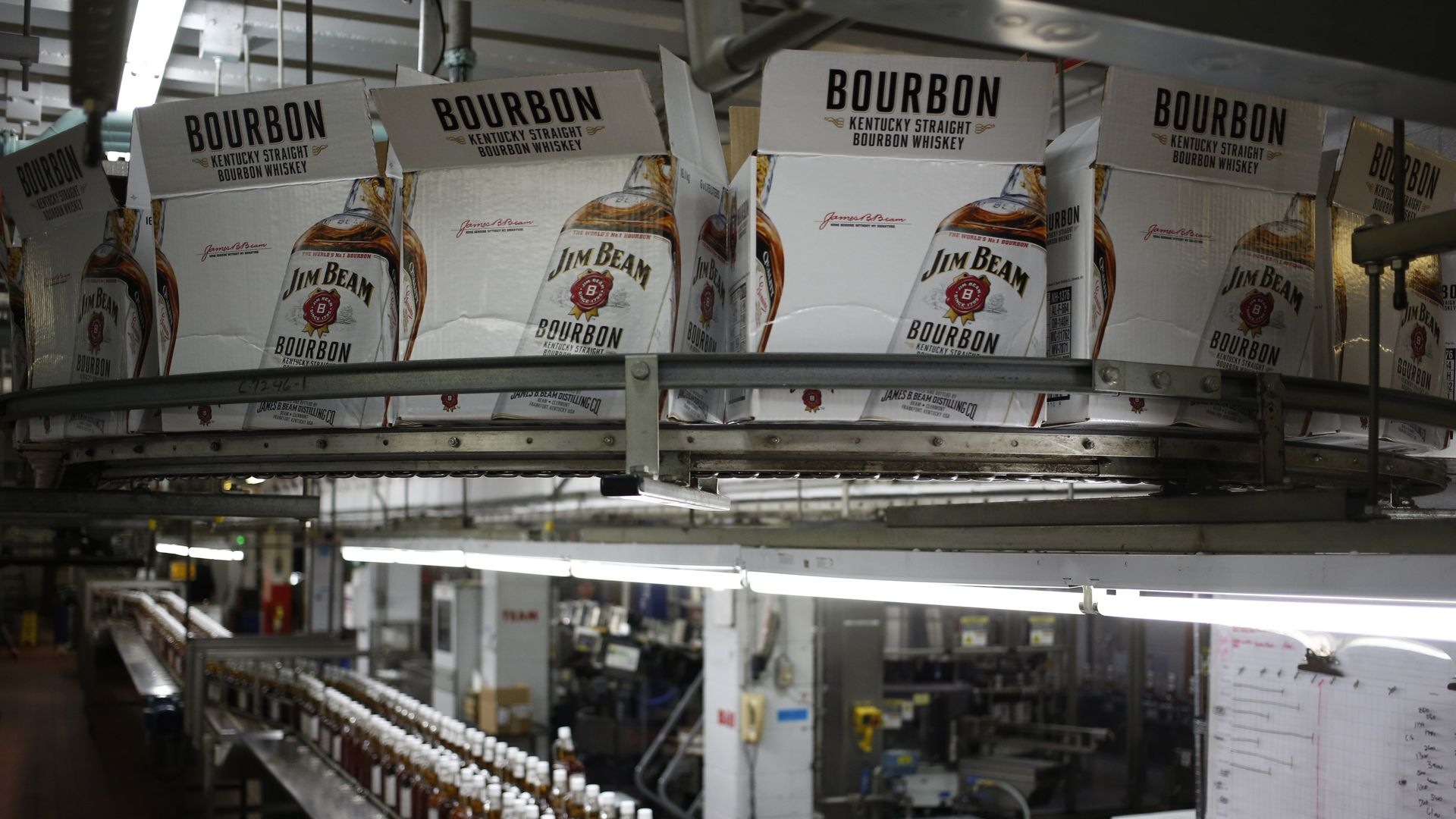 : Bottles of Jim Beam Bourbon make their way down a conveyor belt inside the bottling plant at the Jim Beam Bourbon Distillery on January 13, 2014.