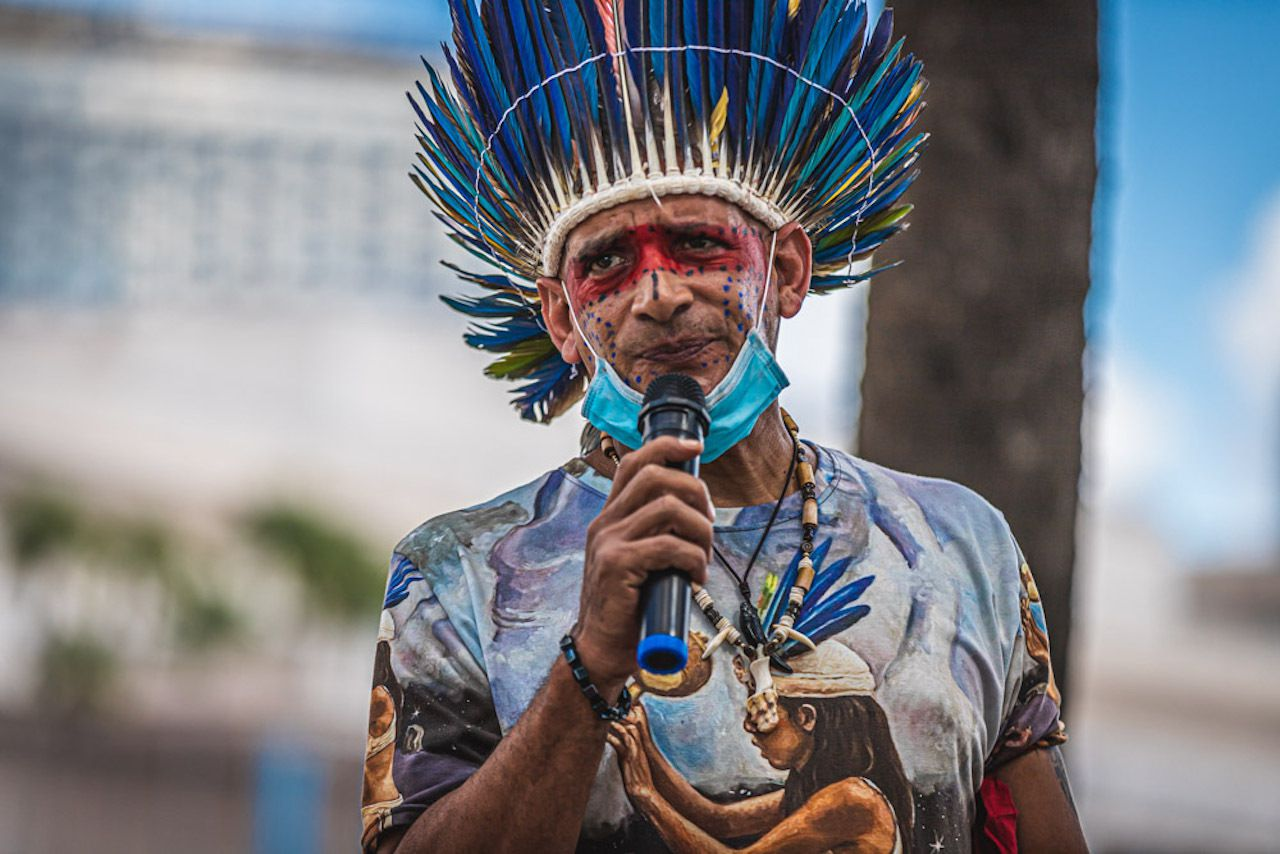 An Indigenous Alliance protester speaks at the Christopher Columbus statue in Tampa on Sunday. Photo: Dave Decker for Creative Loafing