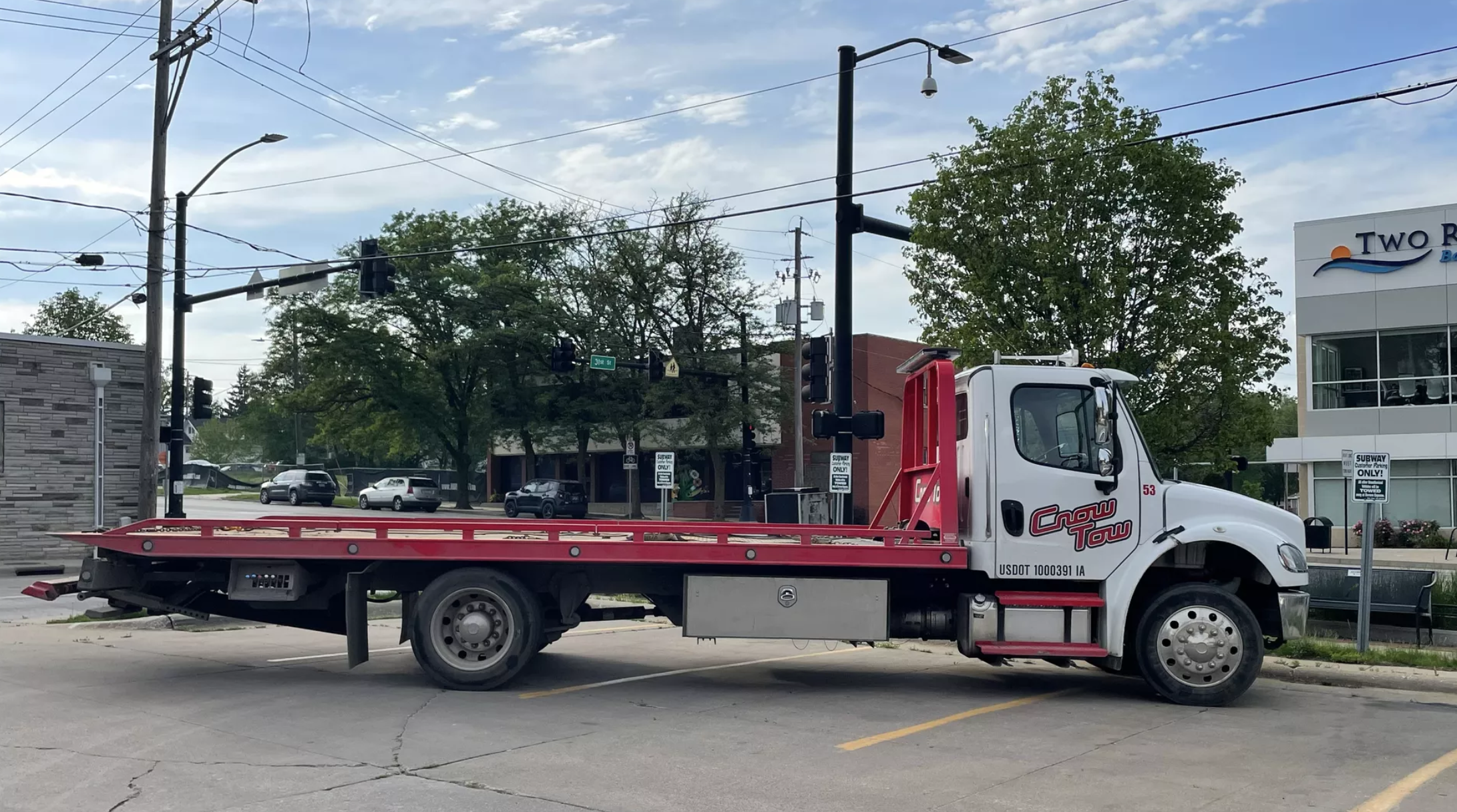 A Crow Tow truck in a Subway parking lot in Des Moines.