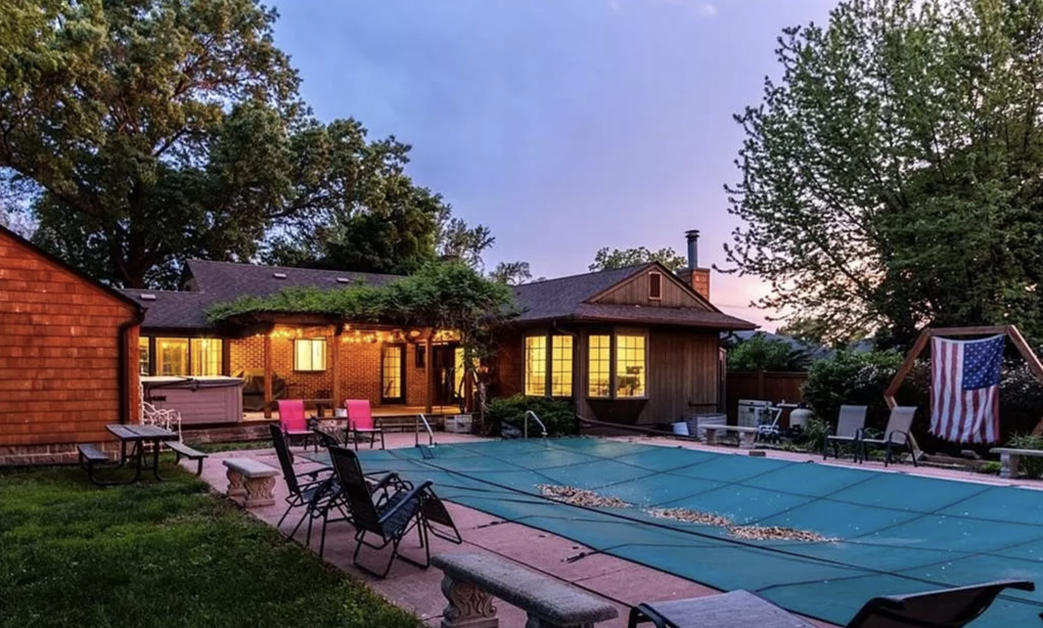 A pool outside a home for sale in Iowa, during sunset.