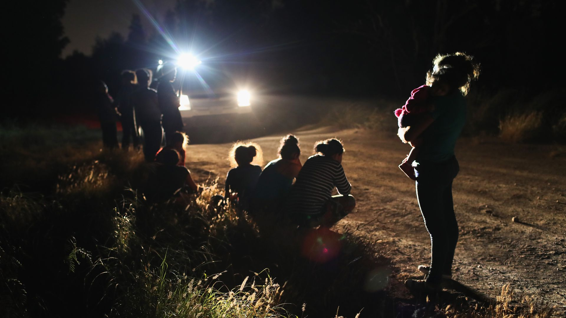 U.S. Border Patrol agents arrive to detain a group of Central American asylum seekers near the U.S.-Mexico border