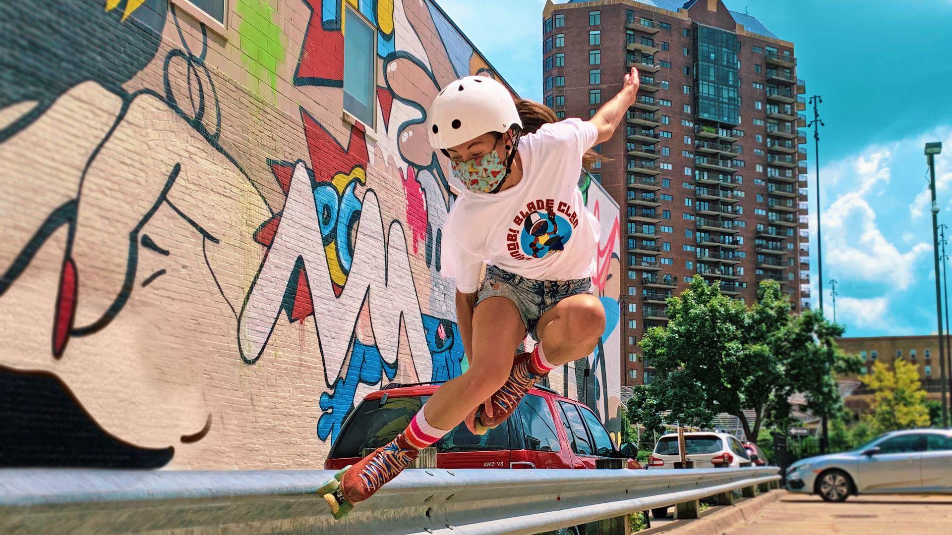 Katie Baird rollerskates off Locust Street in downtown Des Moines.