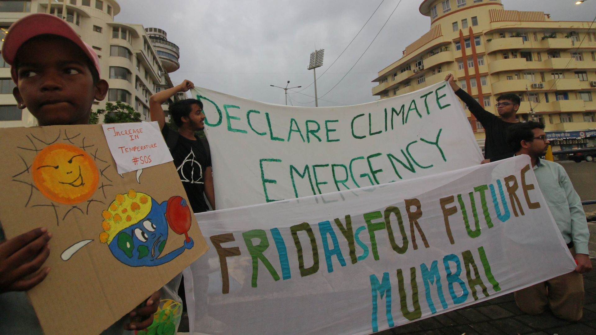 Students participate in a protest against climate change in Mumbai, India.