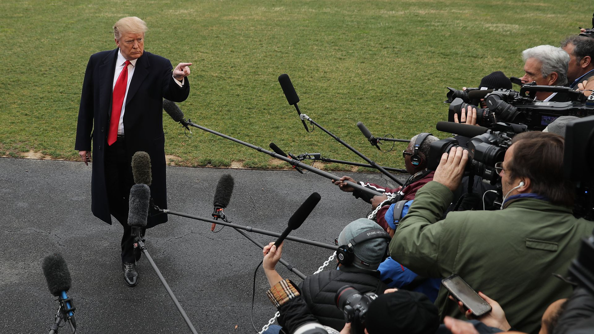 Trump pointing at reporters