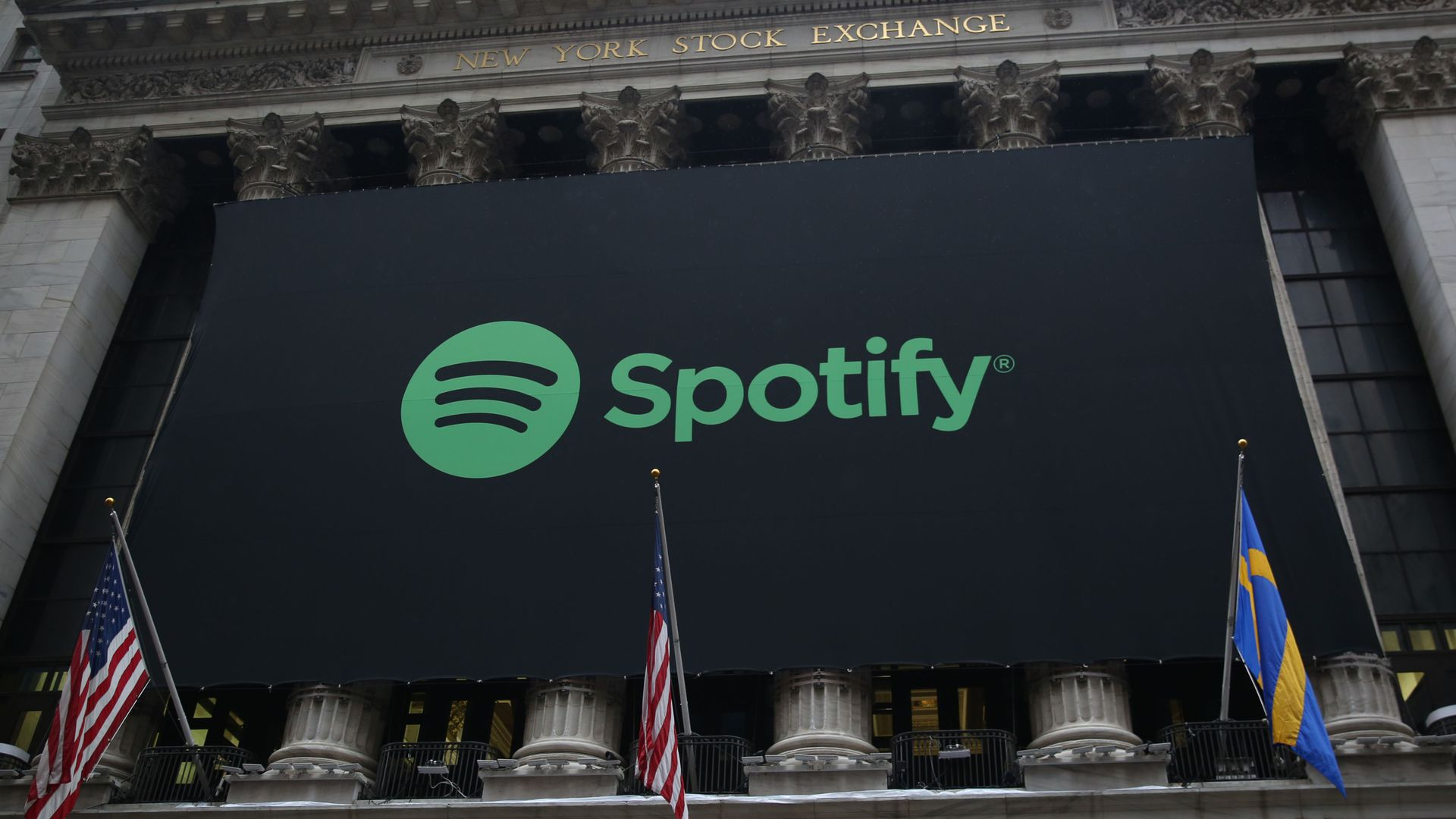 Spotify logo above the NYSE.