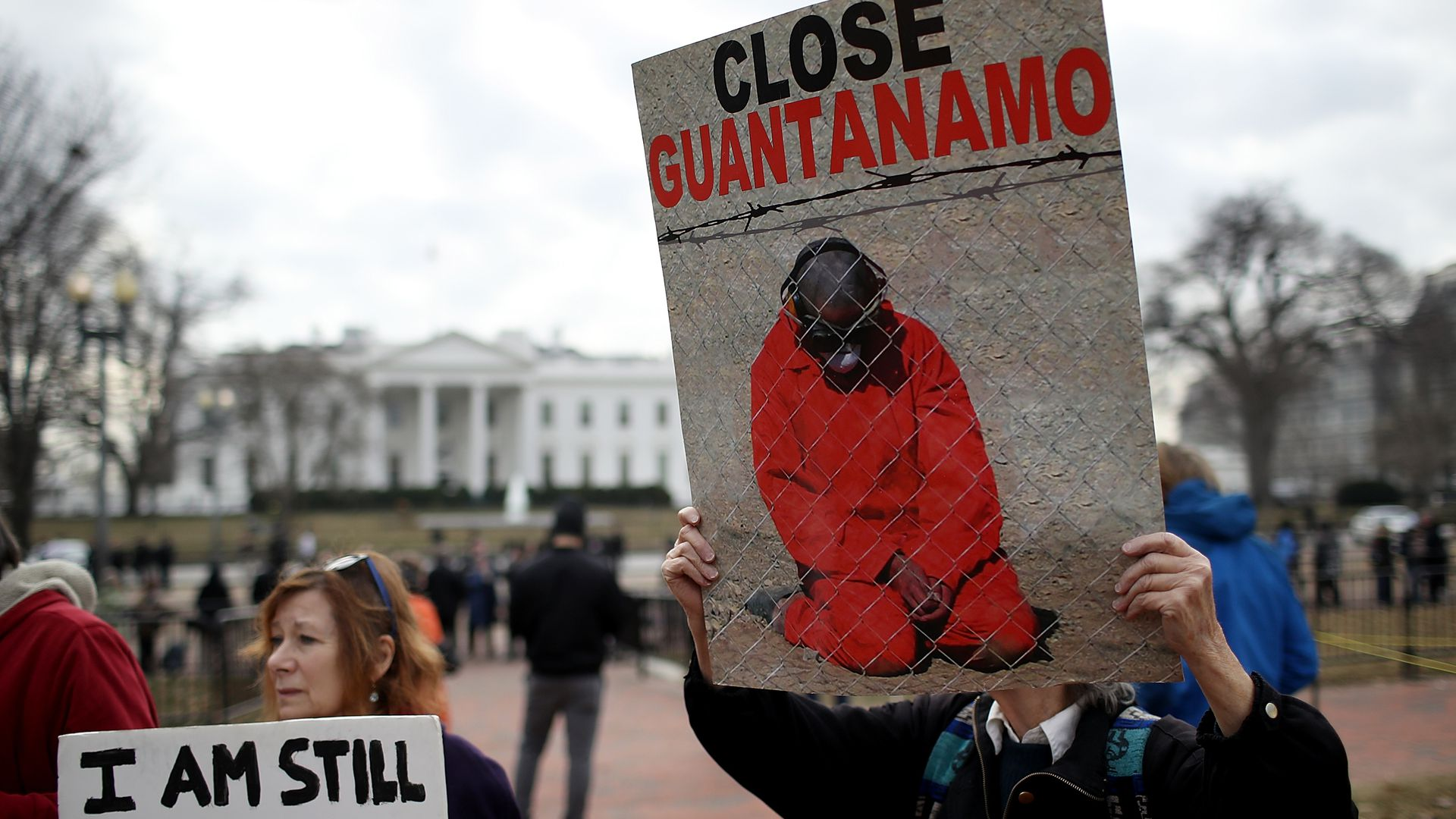 Activists protest the continued operation of the Guantanamo Bay detention camp in front of the White House.