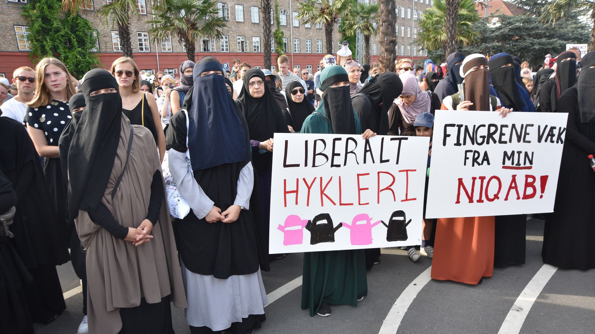 Veiled protestors hold signs in Copenhagen
