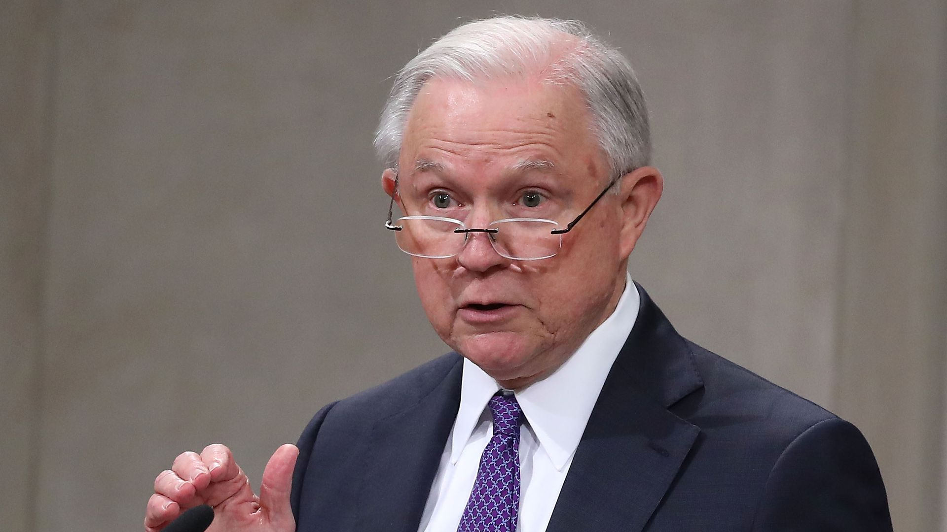 Jeff Sessions speaking into the microphone.