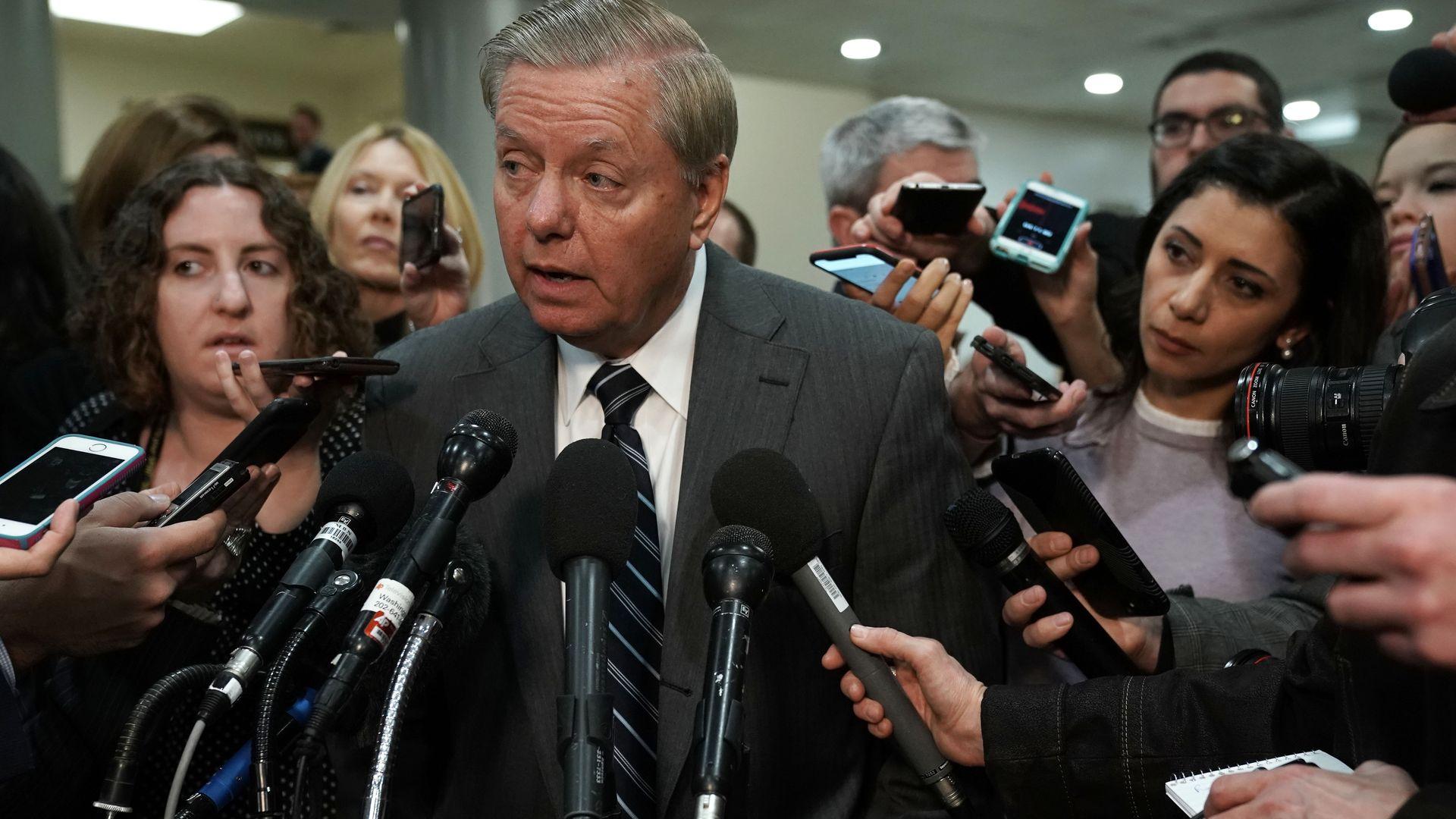 Senator Lindsey Graham surrounded by the media.