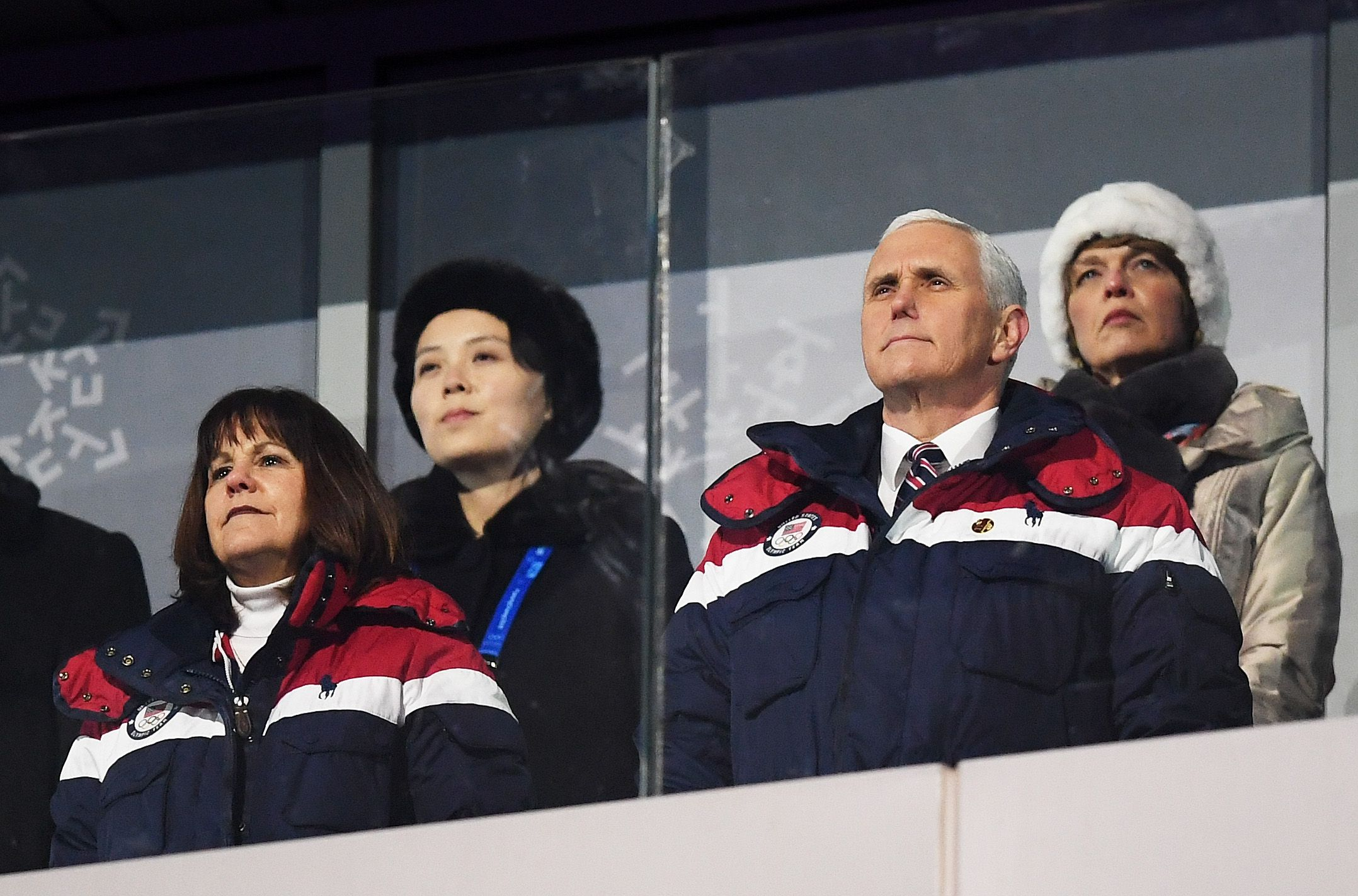 Mike and Karen Pence wearing U.S. Olympic clothes with Kim Jong-un's sister, Kim Yo-jung sitting behind them.