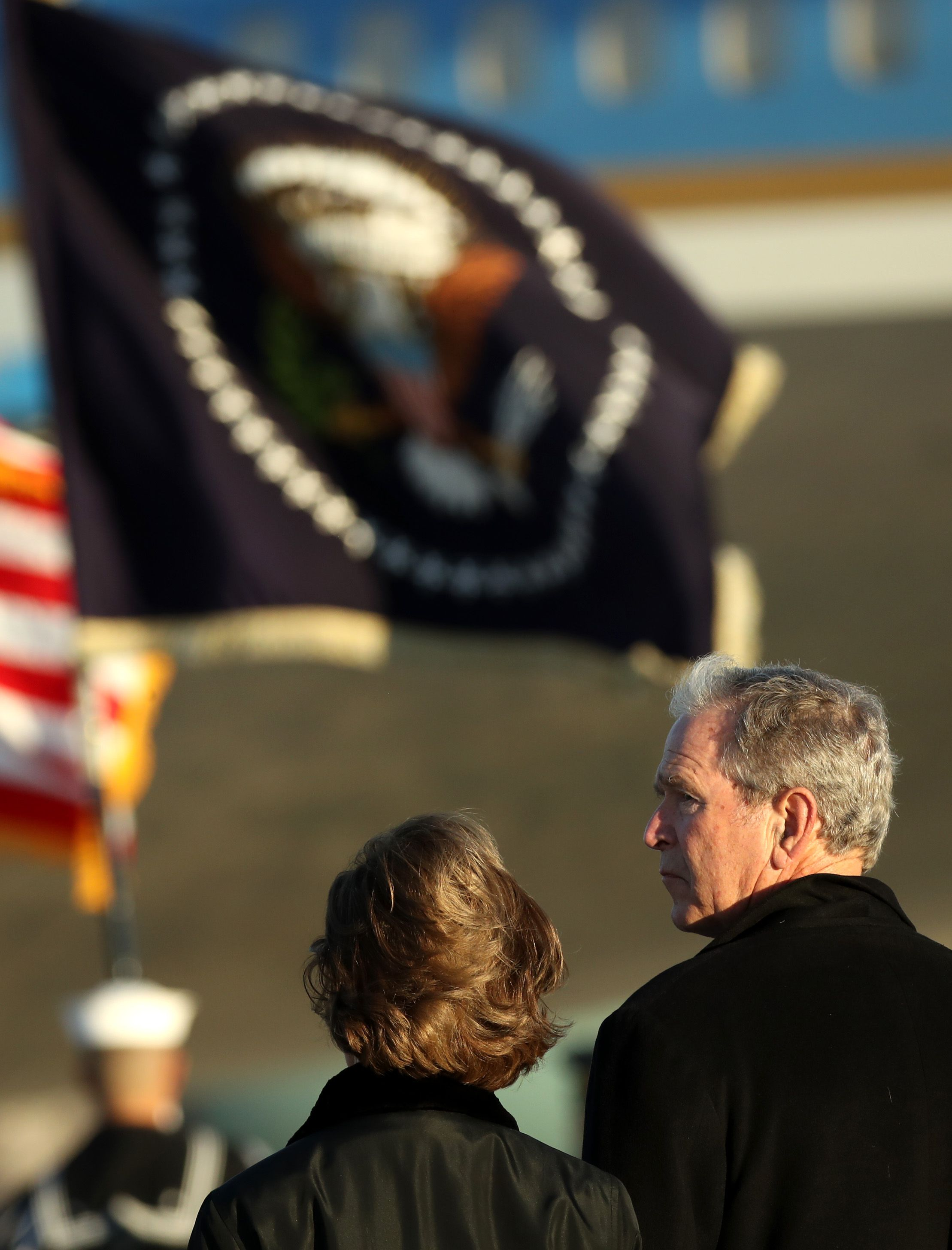 George W. Bush and Laura Bush seen from behind.