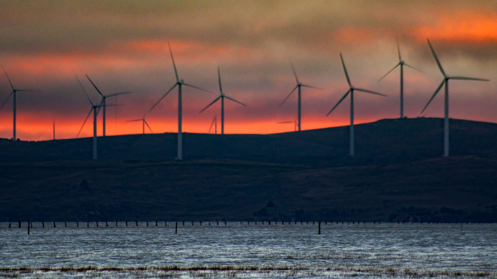 Australian wind turbines during sunset