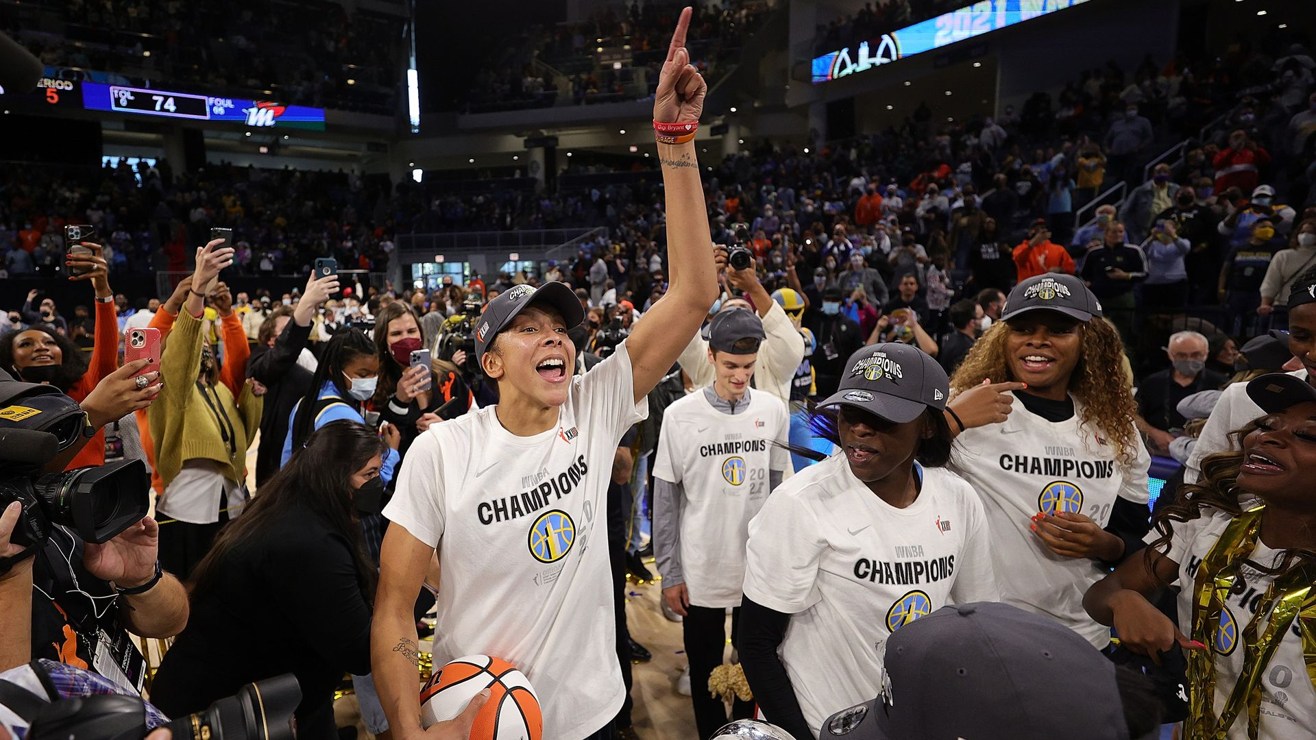 Chicago Sky teammates celebrate on the court.