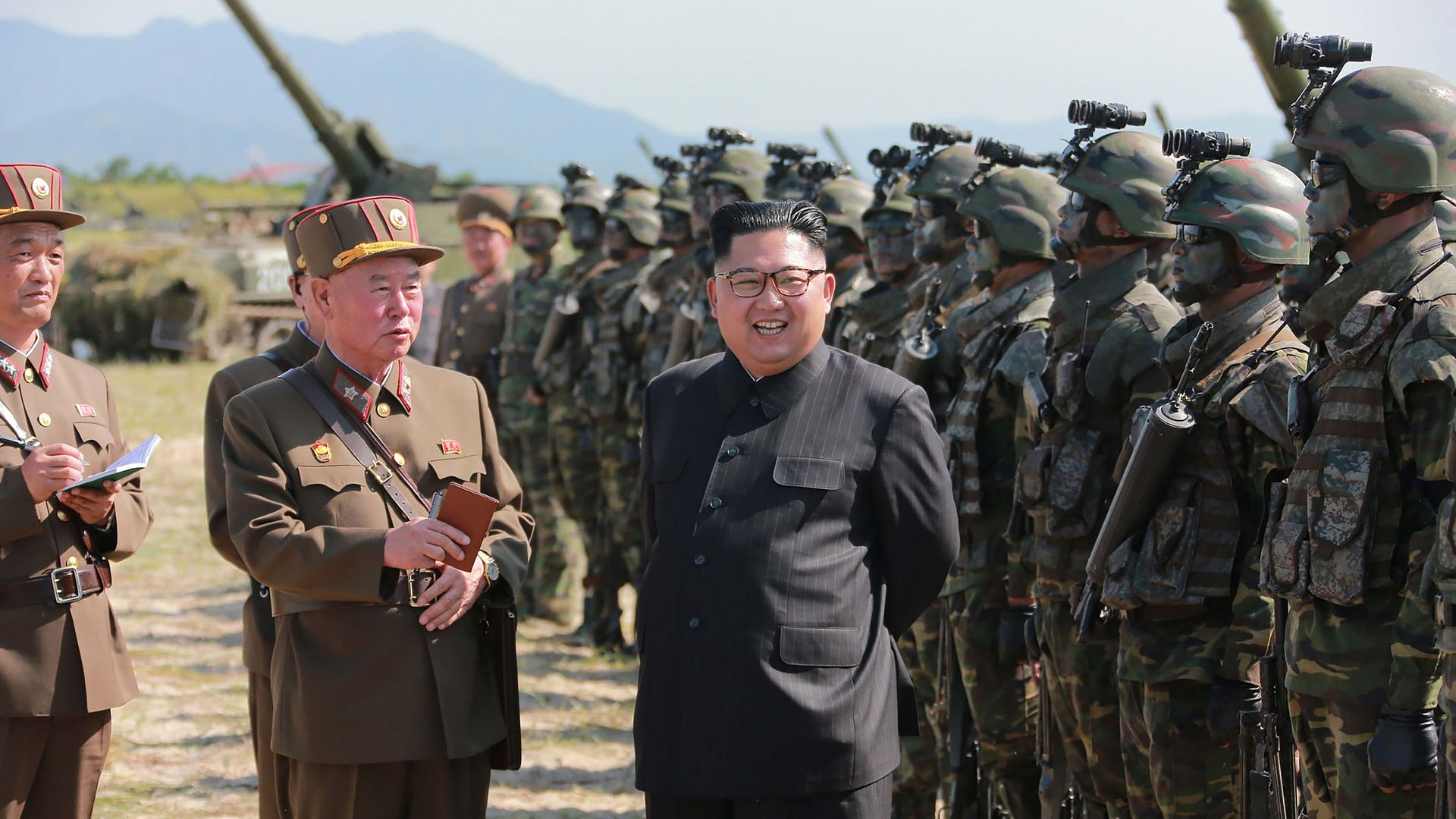 Kim Jong-un stands before the Korean People's Army.
