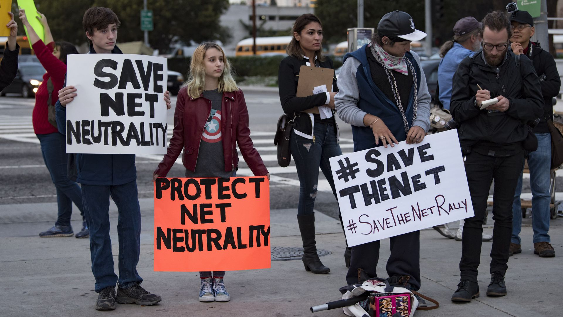 Protesters with signs against repealing net neutrality