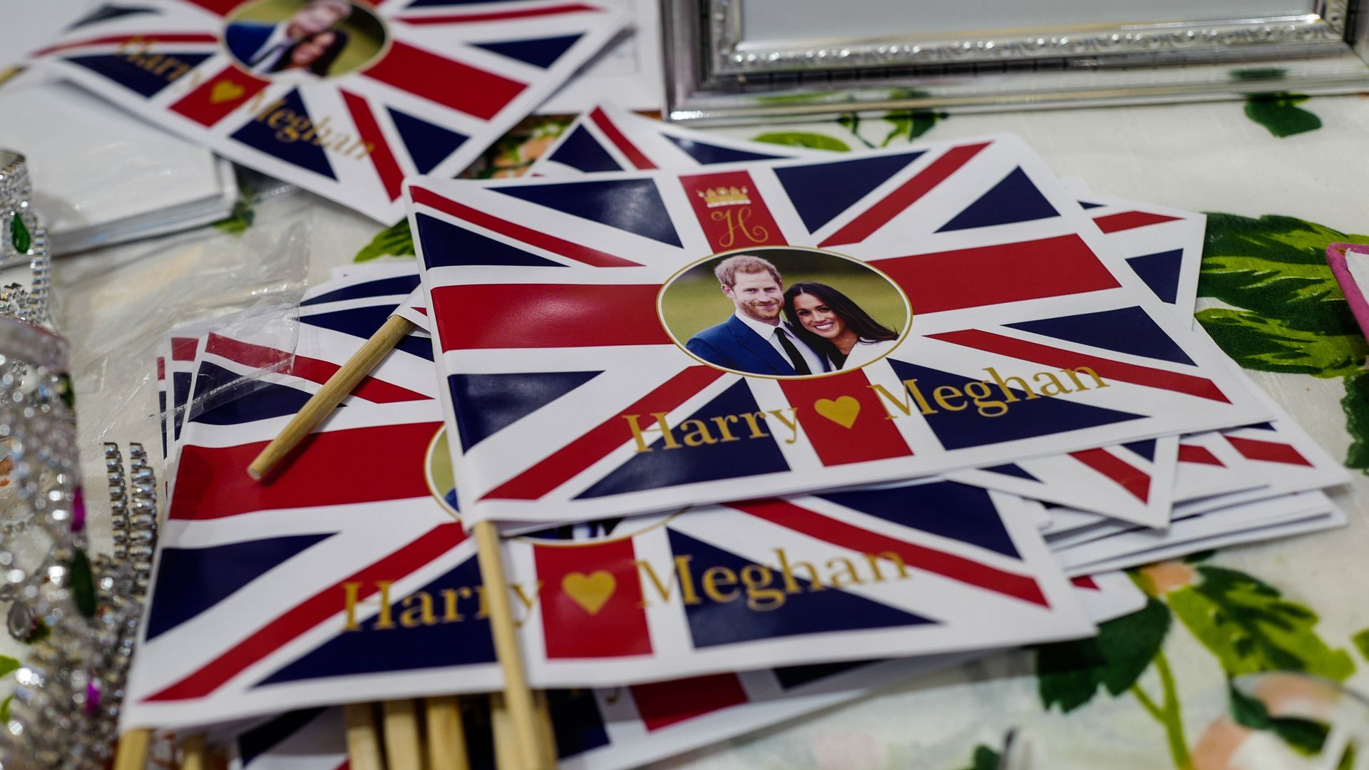 Flags bearing the image of Great Britain's Prince Harry and US actress Meghan Markle