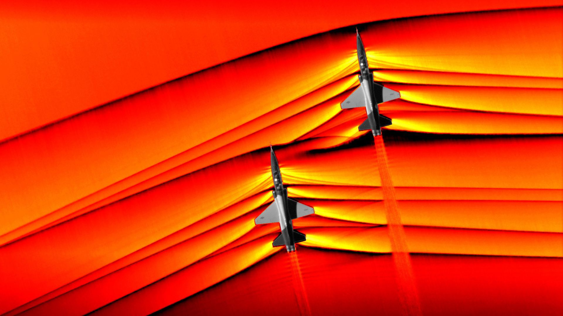 Airplanes breaking the sound barrier.