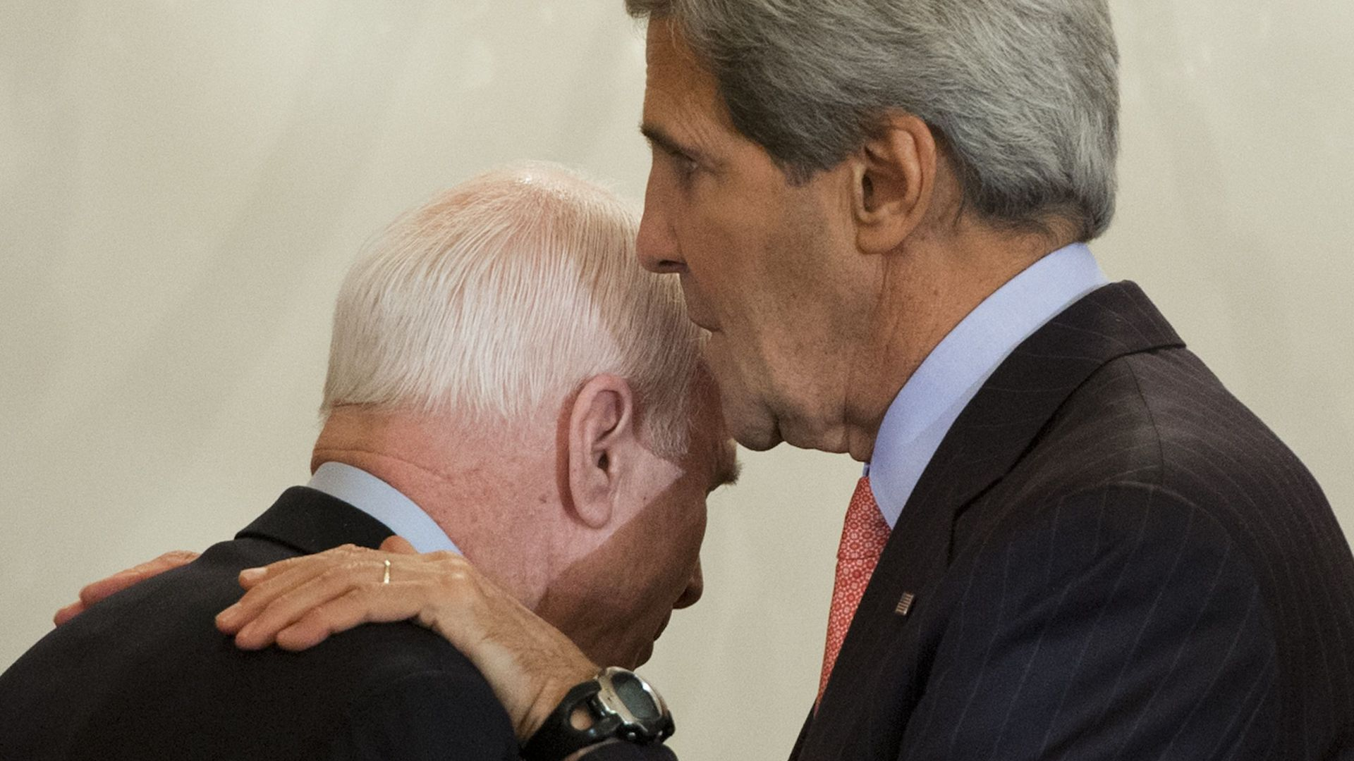 John Kerry talking with John McCain