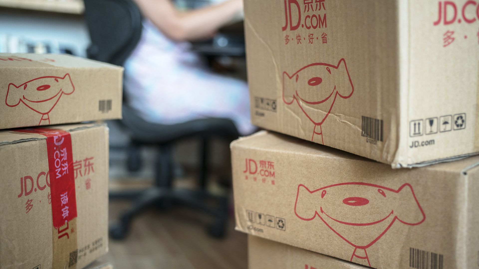 "Boxes that say ""JD.com"" on them."