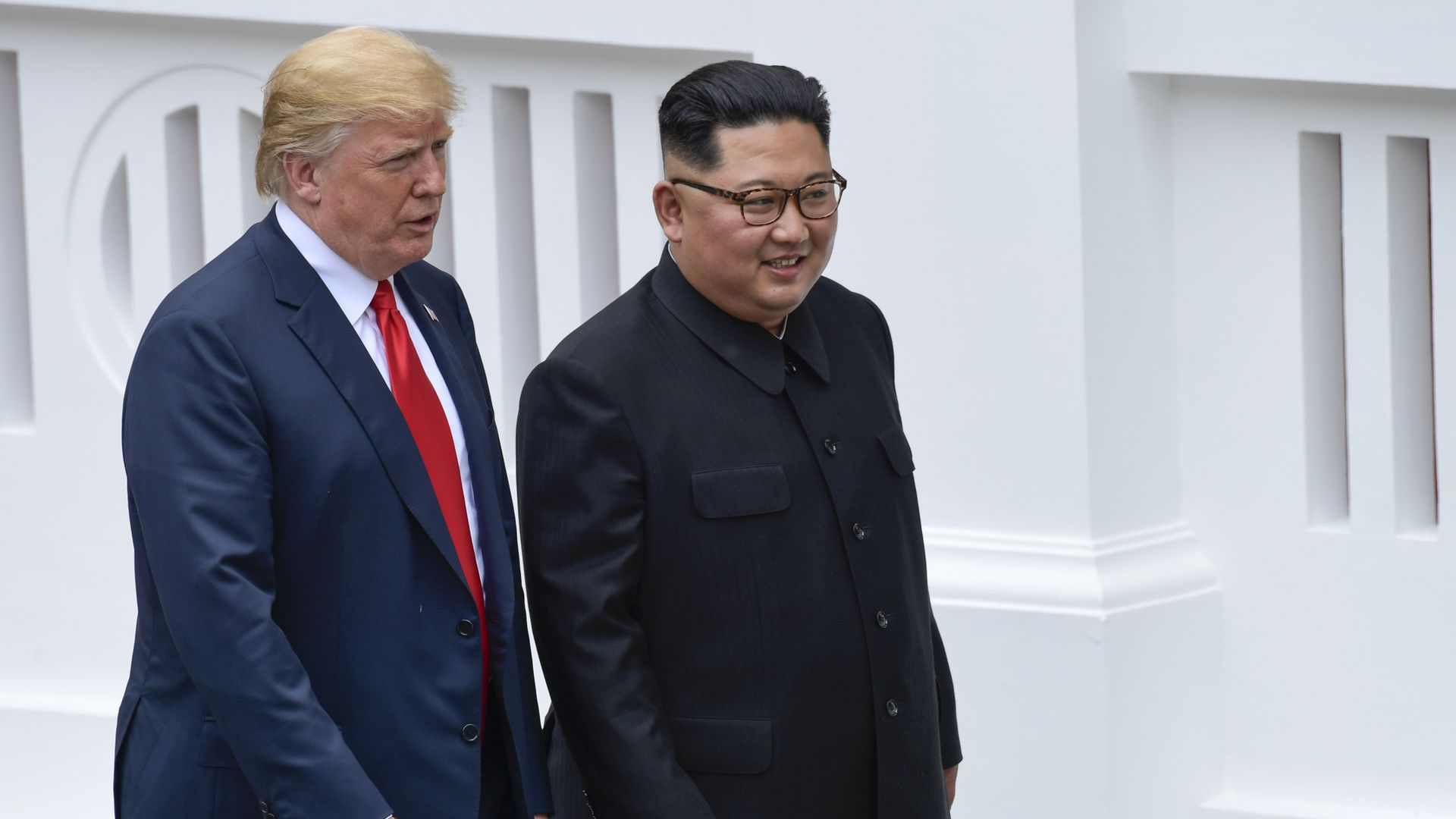 US President Donald Trump and North Korea leader Kim Jong Un walk from lunch at the Capella resort on Sentosa Island in Singapore