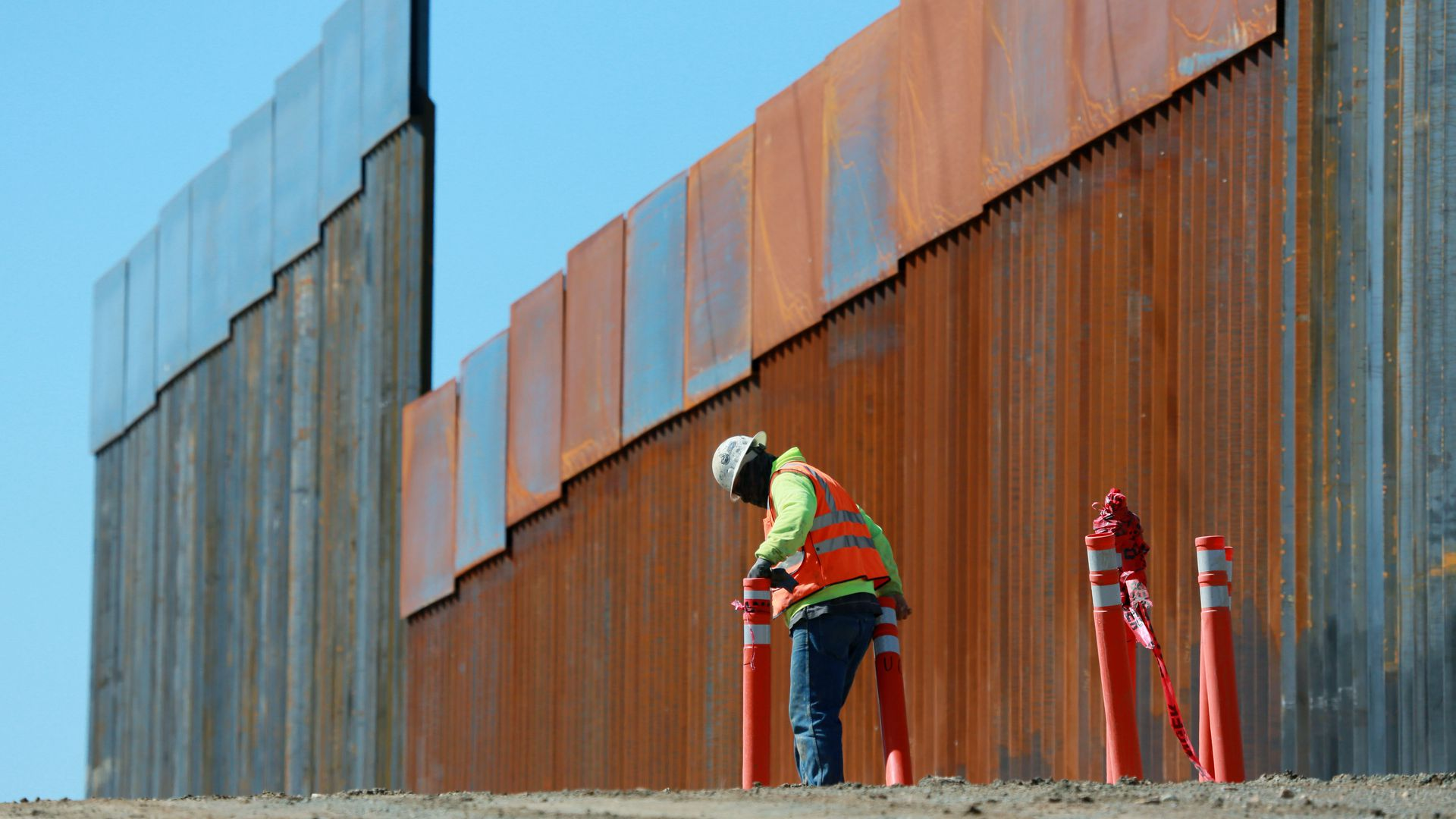 Construction worker build a secondary border wall in February in Otay Mesa, California.