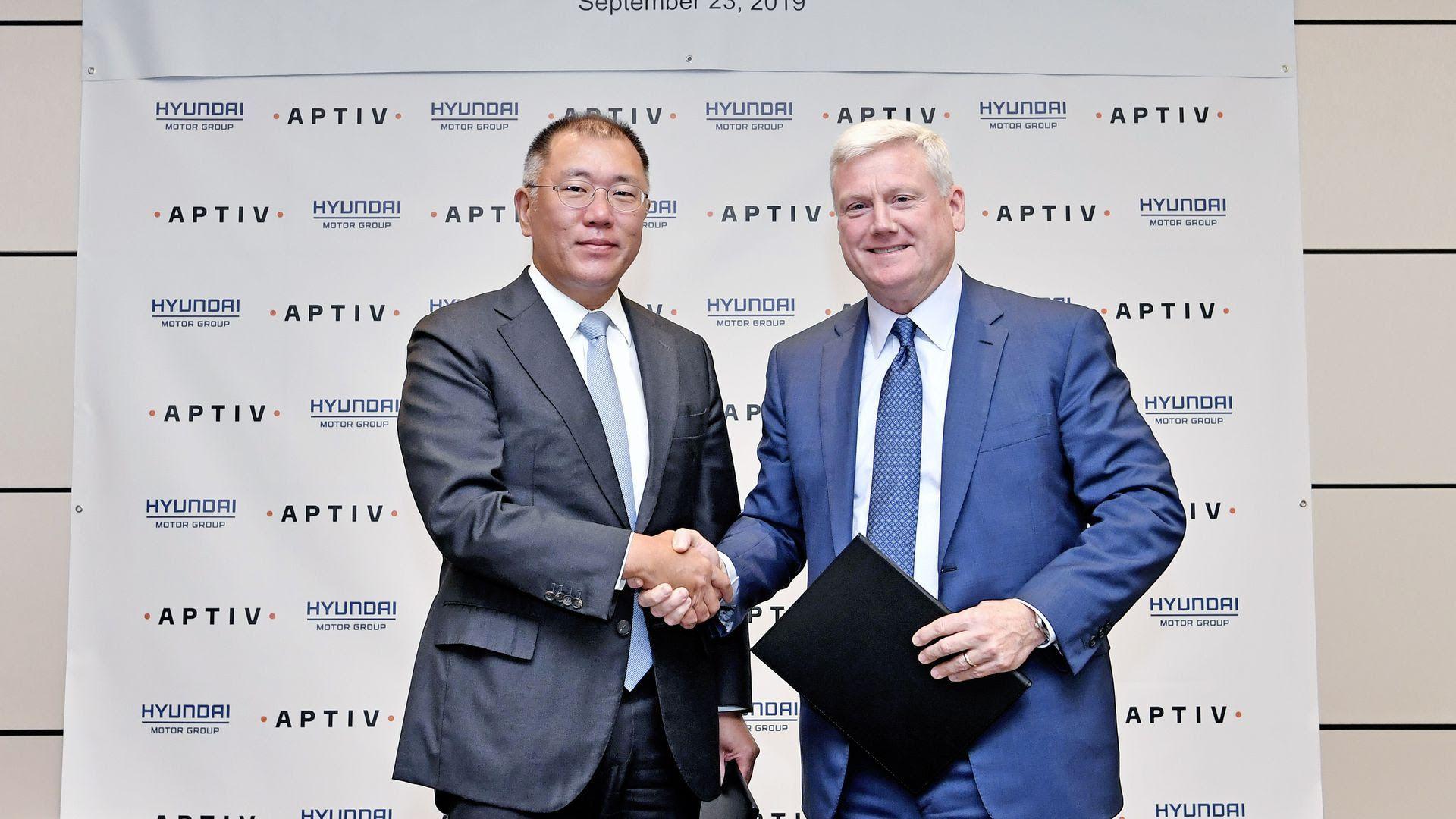 Euisun Chung, executive vice chairman of Hyundai Motor Group and Kevin Clark, president and CEO of Aptiv.