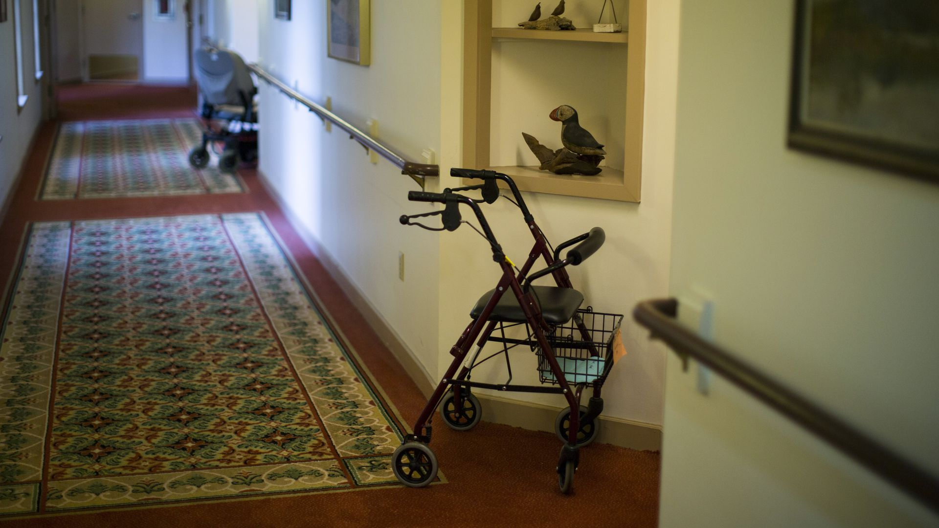 A walker and an electric wheelchair in a nursing home