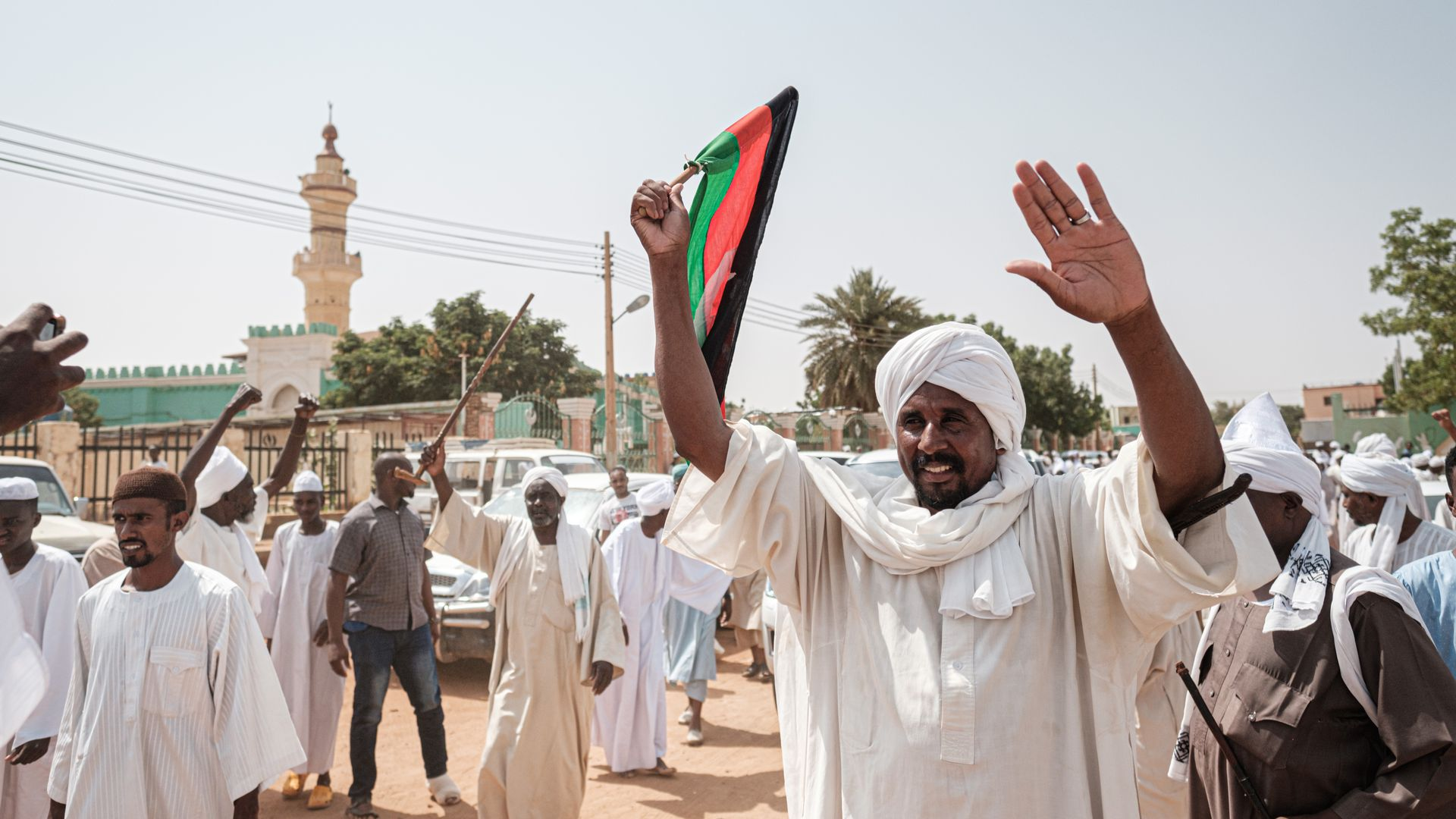 Sudanese citizens leaving a mosque after calls for an investigation into a protest that became violent