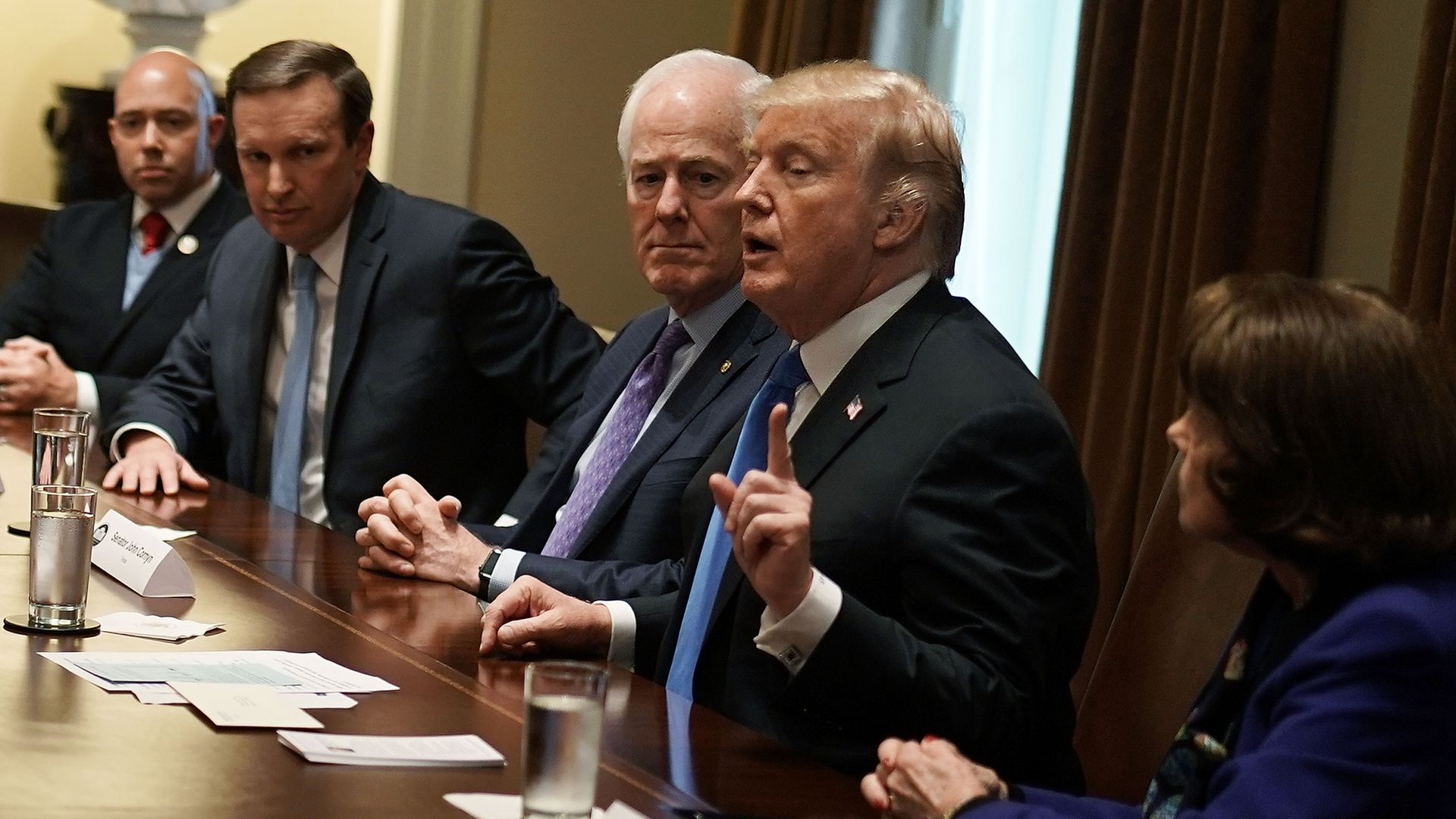 President Trump meeting with lawmakers on gun policy.