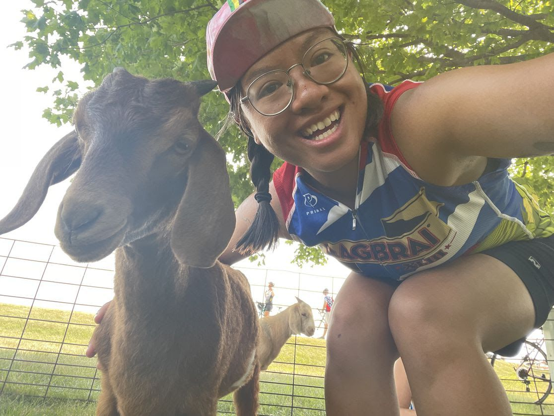 Axios' Linh Ta poses with a goat.