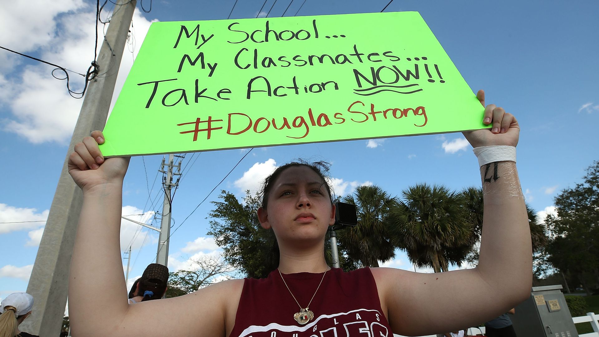 Student Angelia Lazo holds up a sign