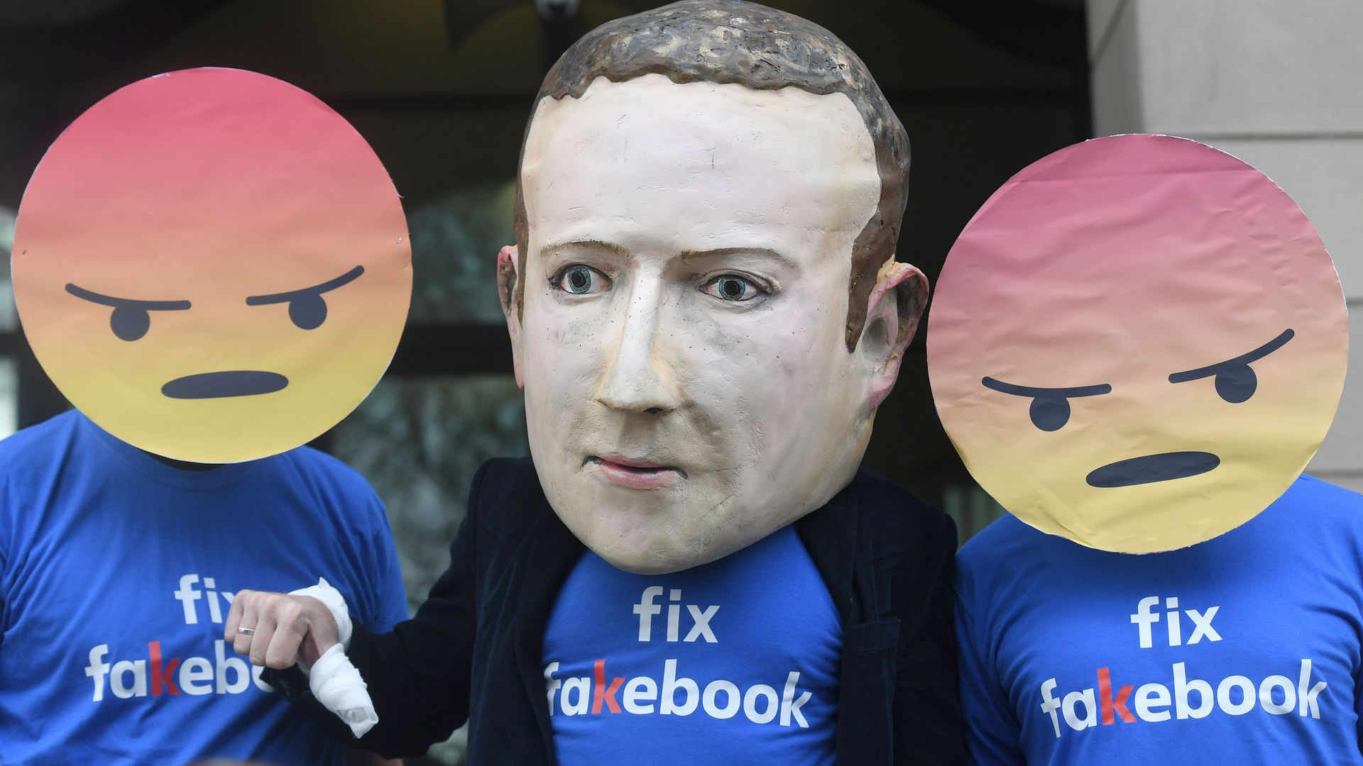 Giant puppet head of Mark Zuckerberg worn by a protester in London